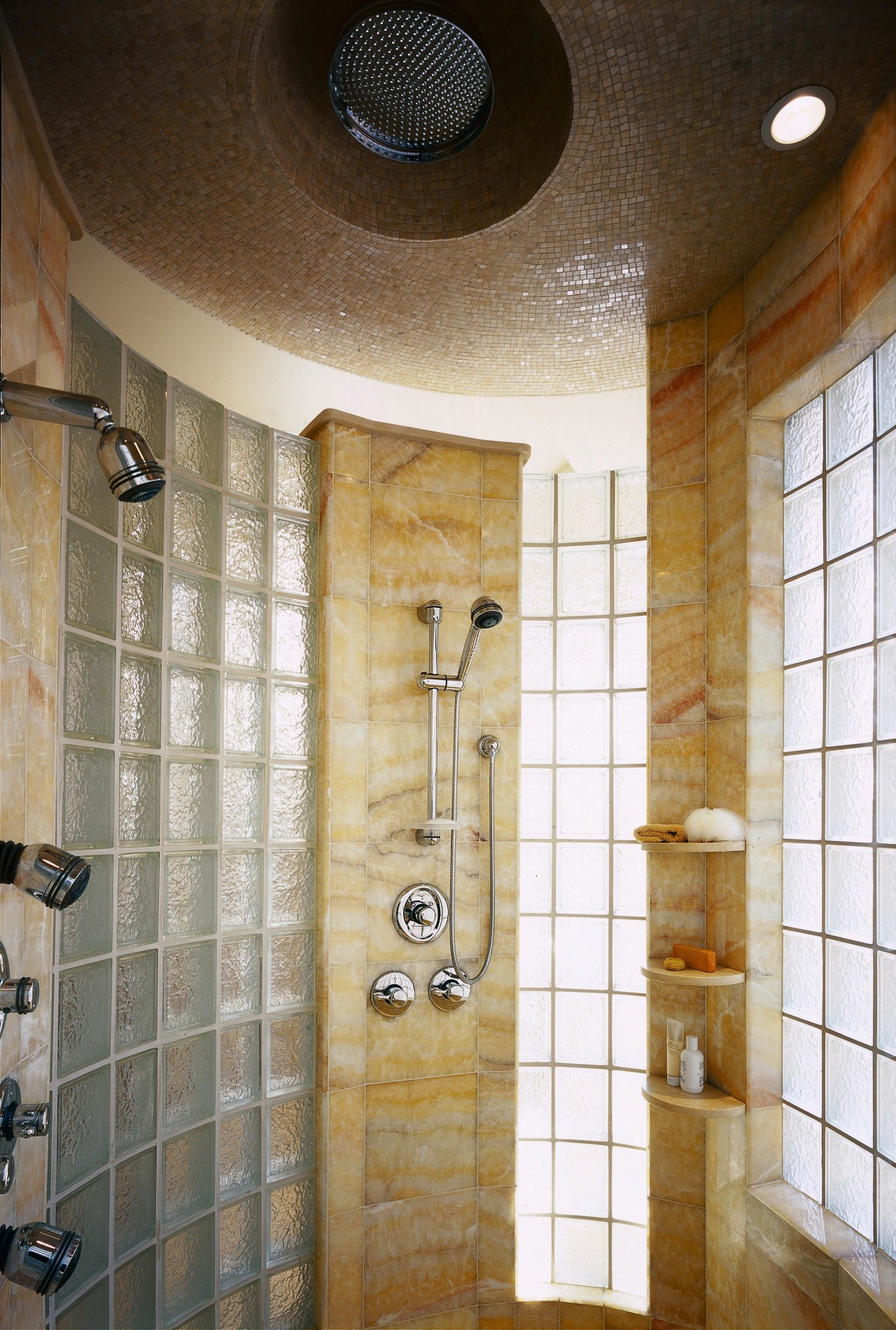 A view of the shower, glass tiled walls, bathroom, ceiling, floor, flooring, interior design, plumbing fixture, room, tile, wall, brown, gray