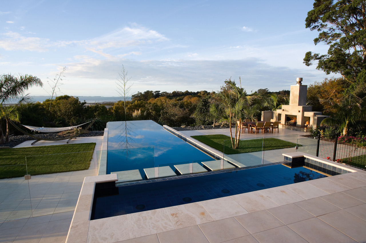 View of this infinity-edge pool built by Frontier architecture, estate, home, house, leisure, property, real estate, residential area, swimming pool, villa, water, gray, teal