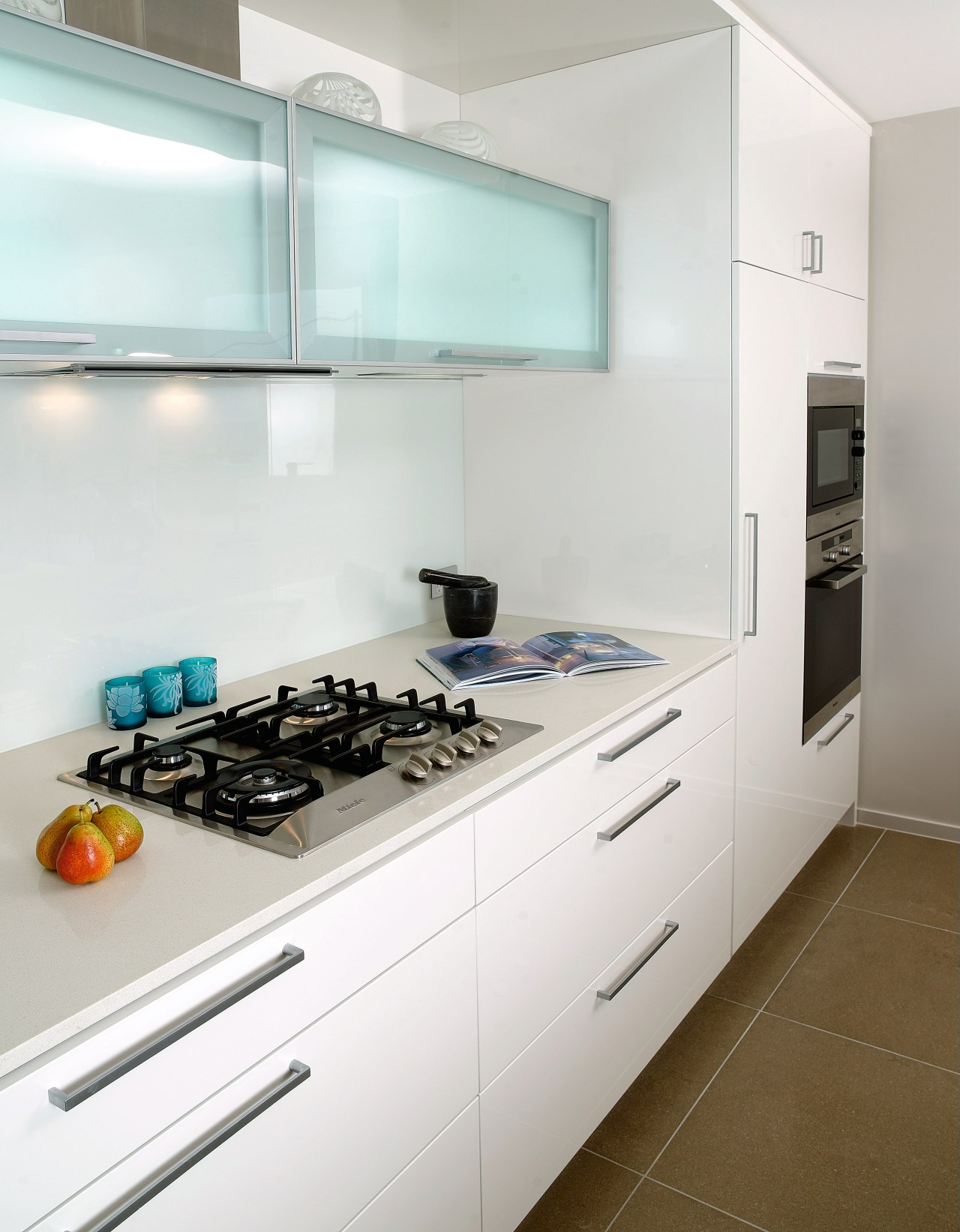 A view of a kitchen with some Miele cabinetry, countertop, home appliance, interior design, kitchen, room, white