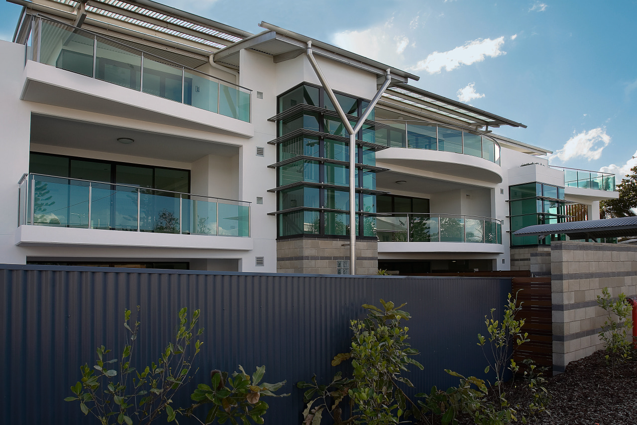 An exterior view of the home. apartment, architecture, building, commercial building, condominium, corporate headquarters, elevation, estate, facade, home, house, mixed use, neighbourhood, property, real estate, residential area, window, black, gray
