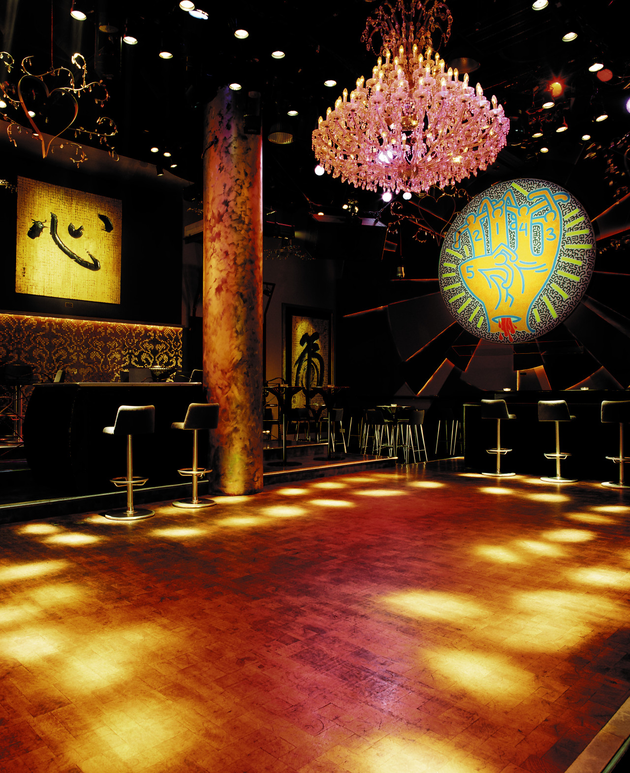 view of the dancefloor featuring end grain wood entertainment, lighting, night, stage, theatre, black