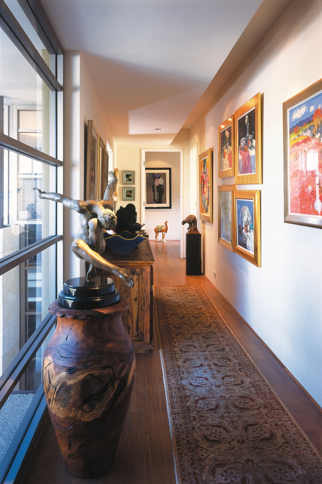 view of the artwork featuring various artworks and floor, flooring, interior design, tourist attraction, white