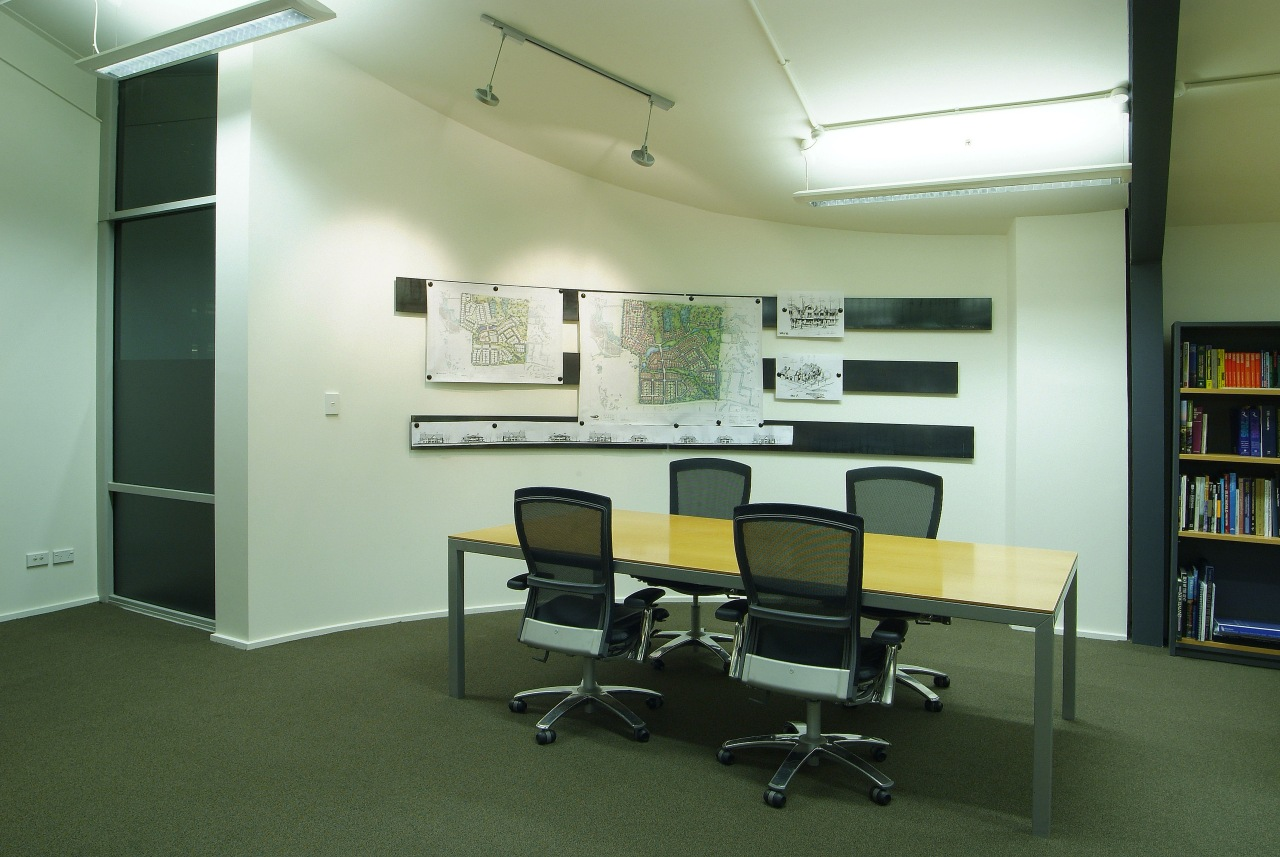 A view of a cream coloured painted wall. classroom, furniture, institution, interior design, office, real estate, green, white