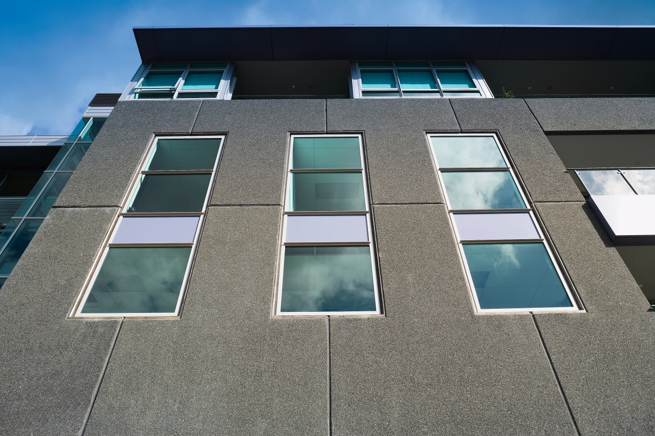 A view of the concrete slabs from Wilco architecture, building, daylighting, daytime, facade, glass, house, line, sky, symmetry, window, black, gray