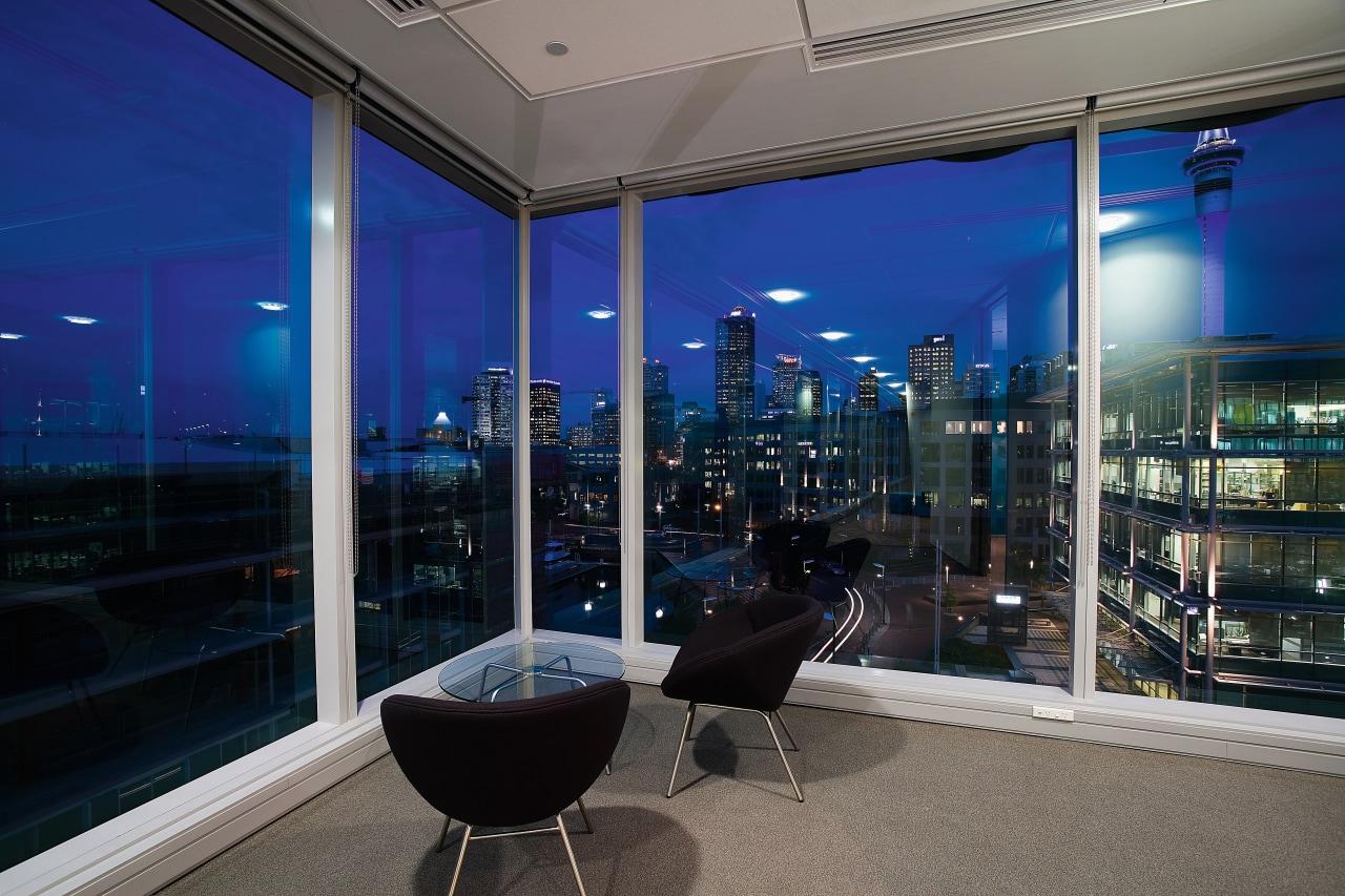 A view of the Microsoft headquarters. apartment, architecture, condominium, glass, interior design, real estate, sky, window, black, blue, gray