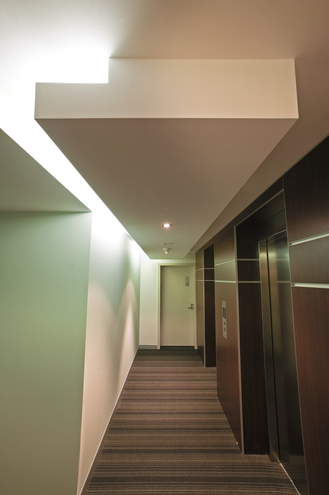 view of the interior of the HUB apartments architecture, ceiling, daylighting, floor, home, house, interior design, light, light fixture, lighting, lobby, stairs, brown