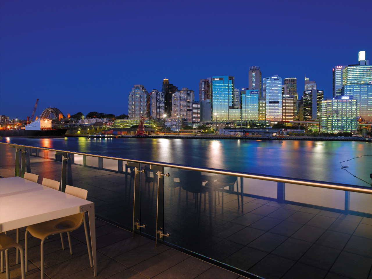 view from the sunders wharf apartments looking at apartment, architecture, city, cityscape, condominium, downtown, dusk, evening, home, lighting, metropolis, metropolitan area, night, real estate, reflection, residential area, roof, sky, skyline, skyscraper, tower block, urban area, water, blue, black