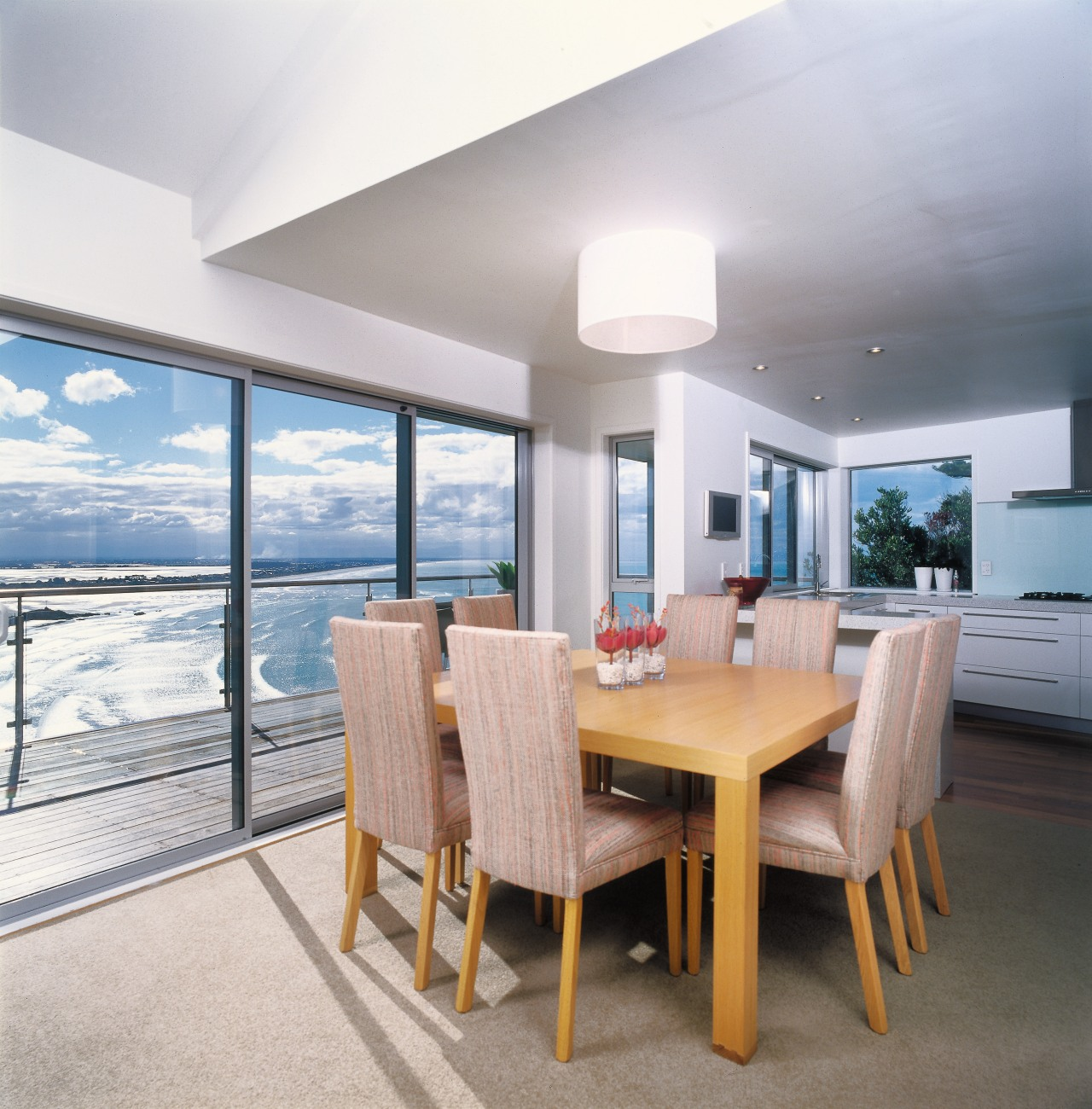 A view of some faucetry from Hansgrohe. ceiling, dining room, interior design, real estate, table, window, gray, white