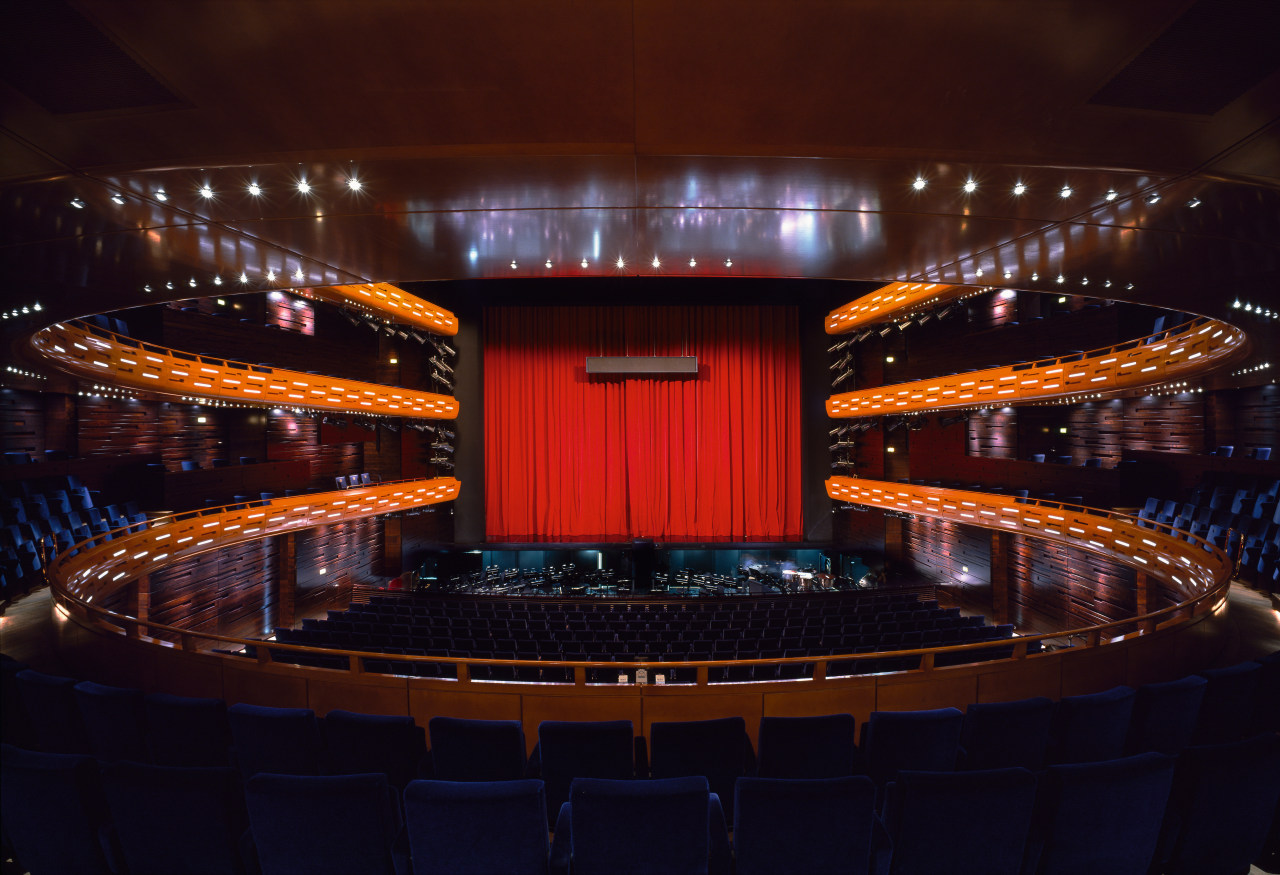 A view of the auditorium. auditorium, concert hall, entertainment, lighting, night, performing arts center, stage, theatre, red, black