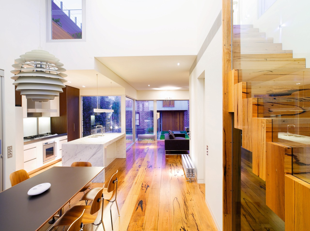 A view of the kitchen and dining areas, apartment, architecture, ceiling, house, interior design, living room, real estate, white