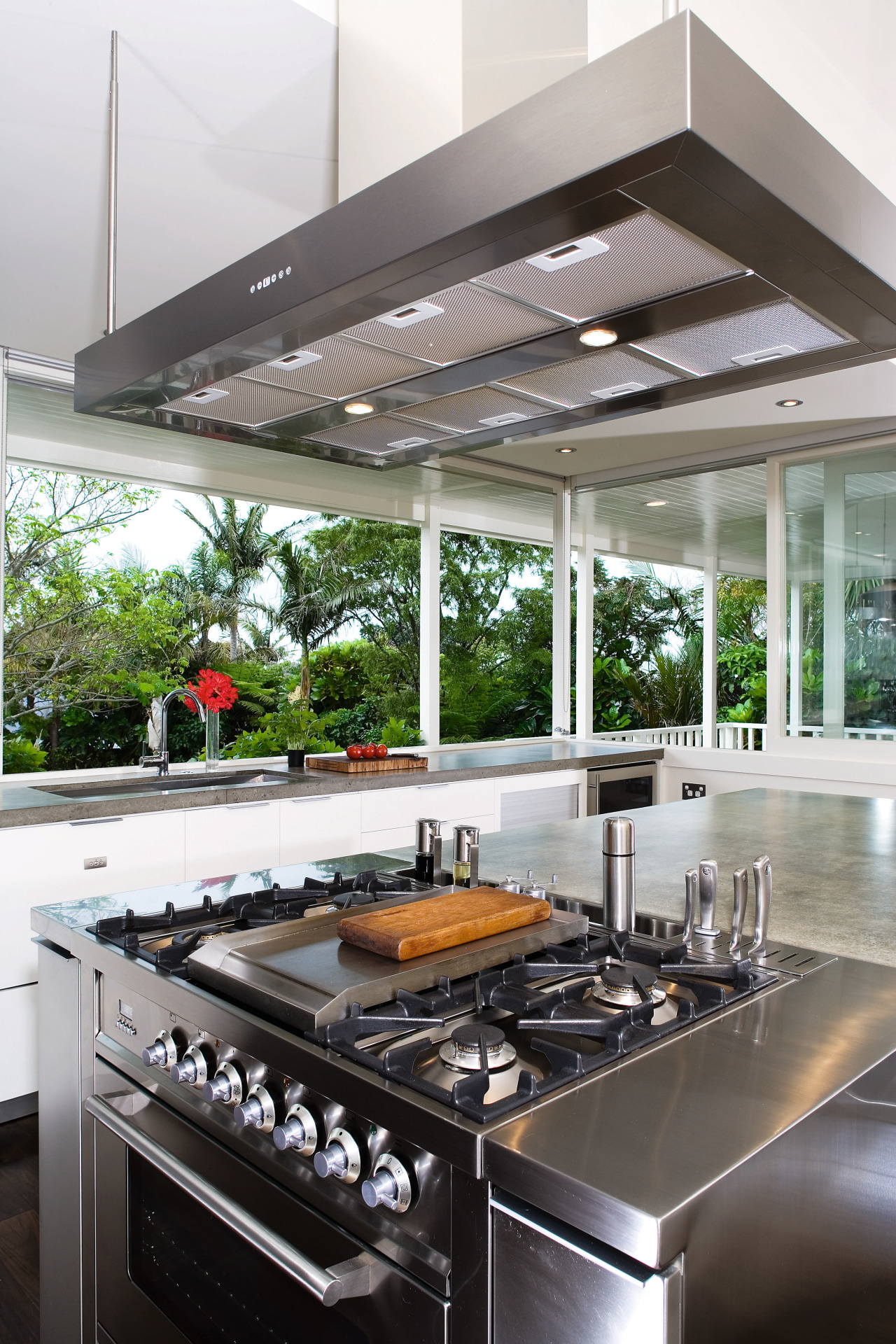 A close up view of the cooktop and countertop, interior design, kitchen, white, gray