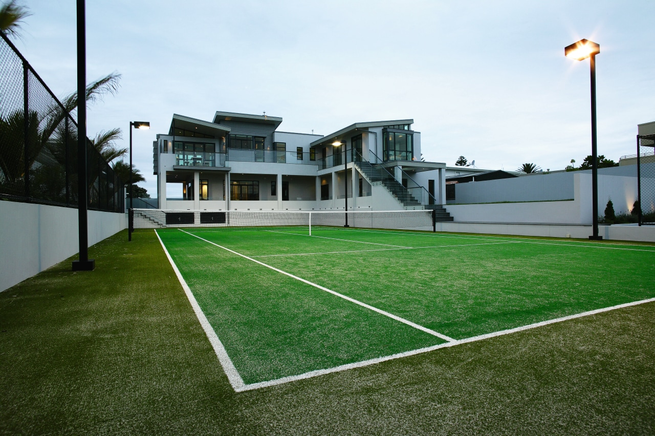 A view of some turf from TigerTurf. artificial turf, ball game, estate, grass, house, lawn, leisure, leisure centre, plant, property, real estate, sport venue, sports, structure, white