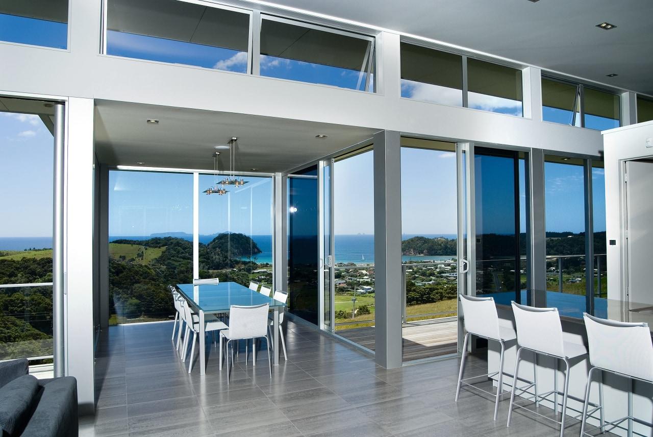 View of the living areas in this matapouri condominium, daylighting, door, house, interior design, real estate, window, white, gray