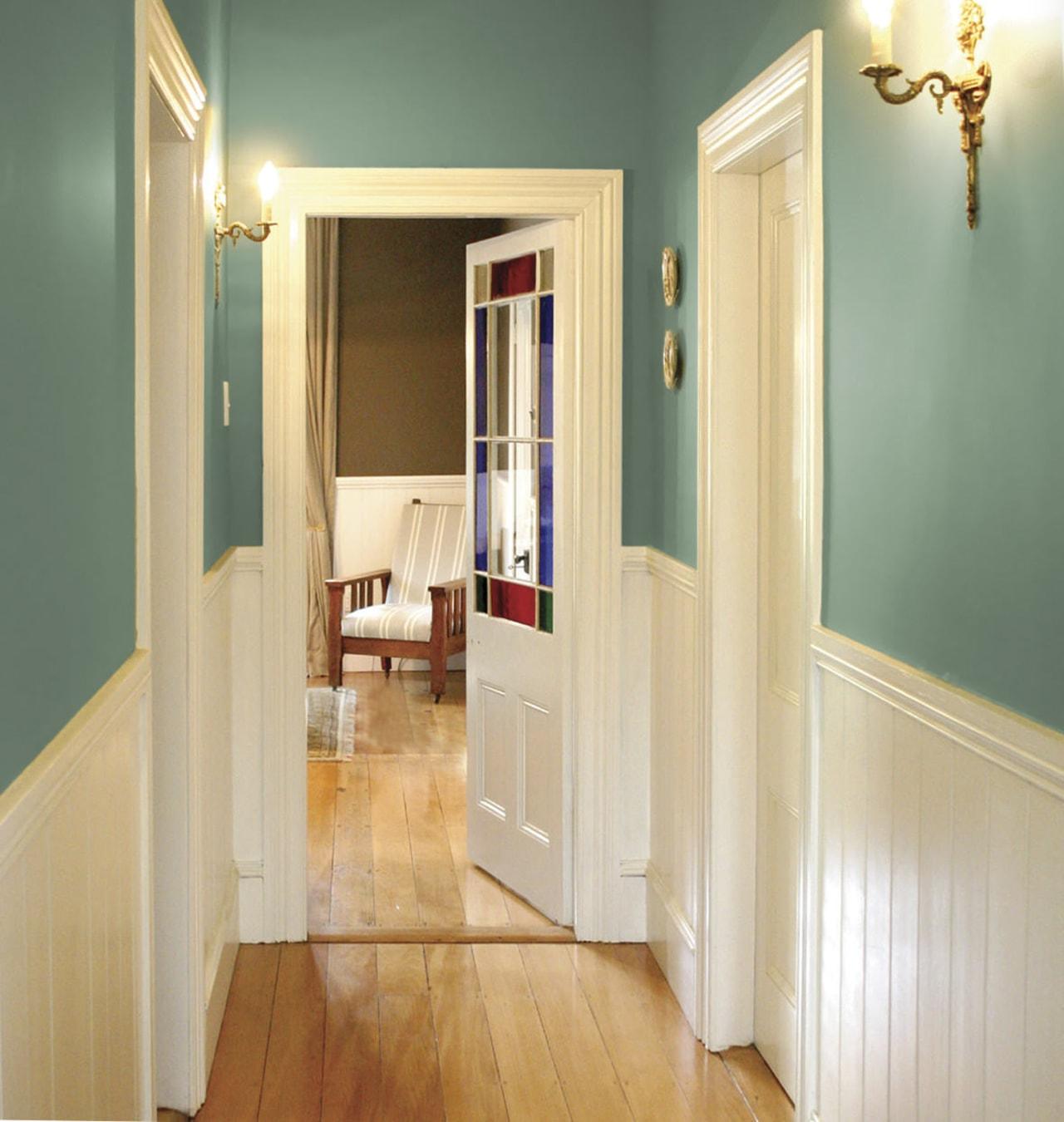 Country lodge painted in Resene shades hallway in ceiling, door, floor, flooring, hall, hardwood, home, house, interior design, laminate flooring, lighting, molding, property, real estate, room, wall, window, wood, wood flooring, wood stain, orange, green