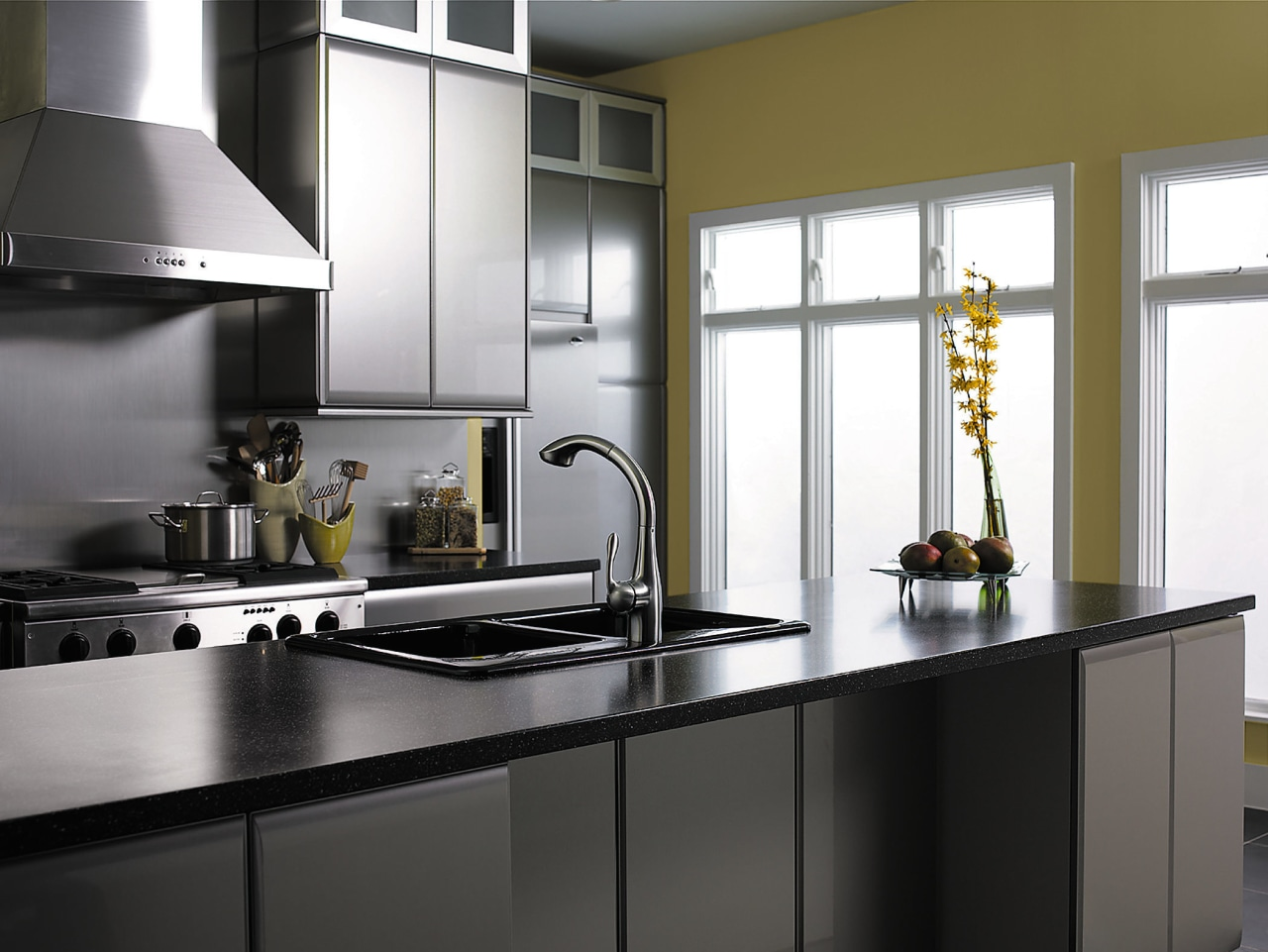 View of this kitchen featuring hansgrohe stainless steel cabinetry, countertop, cuisine classique, home appliance, interior design, kitchen, product design, black, white