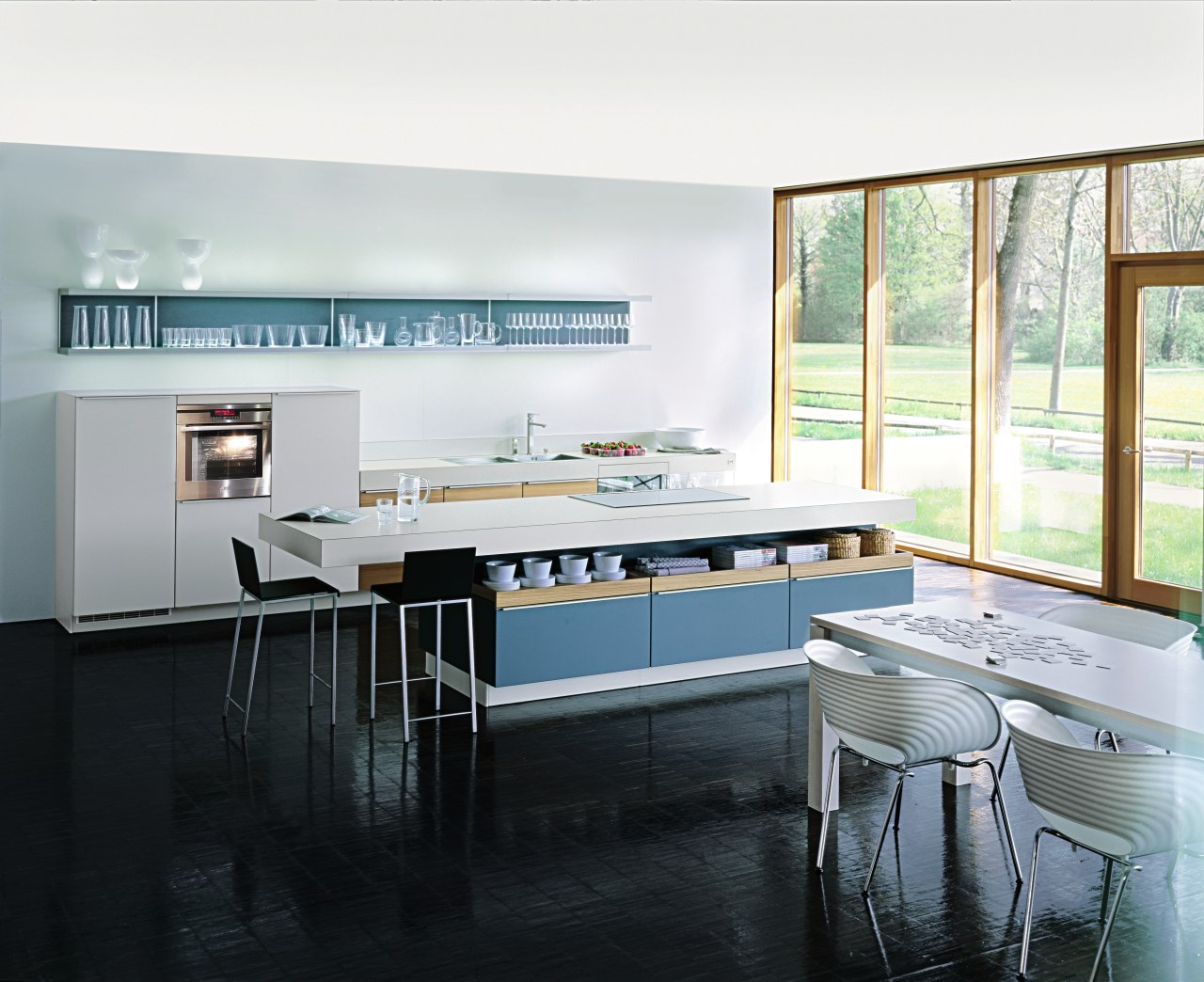 A view of some kitchen appliances from AEG. countertop, interior design, kitchen, room, window, white, black