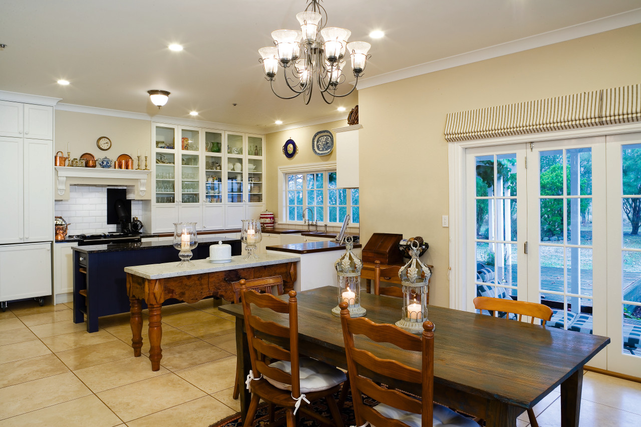 A view of the kitchen and dining areas, dining room, interior design, kitchen, property, real estate, room, table, gray