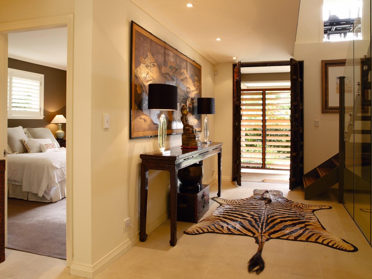 The houses front door s were relocated to floor, flooring, interior design, real estate, room, suite, orange, brown
