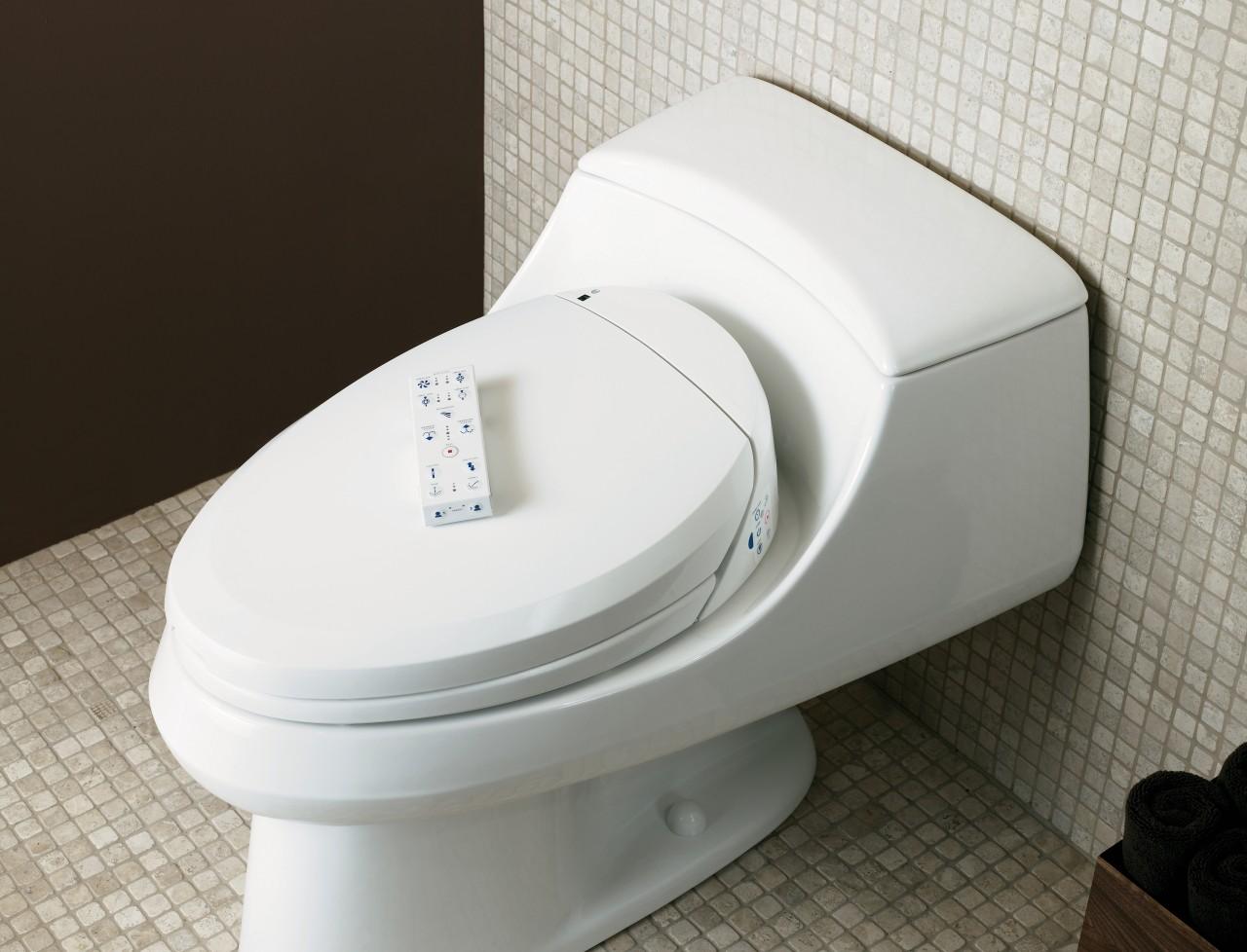 The Kohler C toliet seat offers a choice bidet, hardware, plumbing fixture, product, product design, toilet, toilet seat, white, black, gray