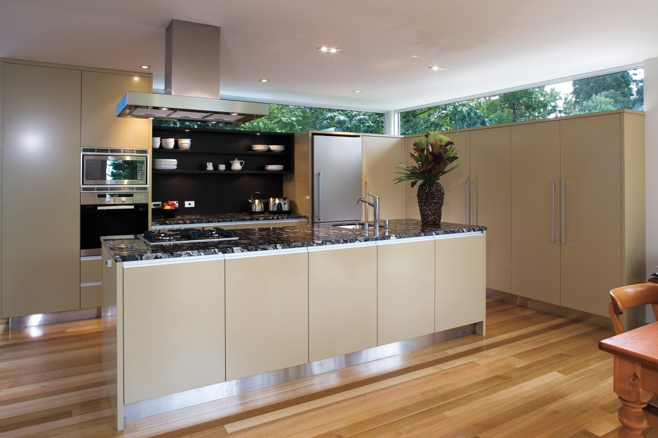 A view of this kitchen featuring polished timber cabinetry, countertop, interior design, kitchen, gray, brown