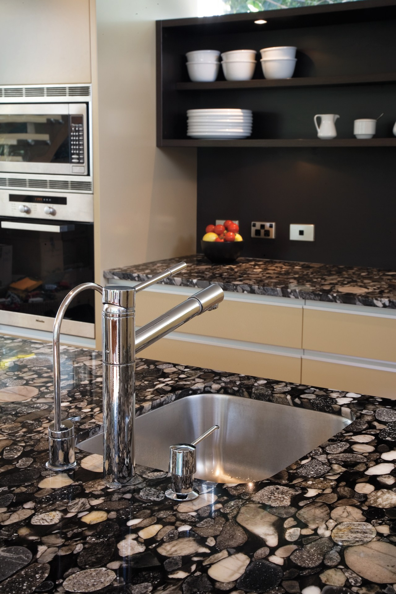 A view of this kitchen featuring polished timber countertop, floor, flooring, interior design, kitchen, tile, black, gray