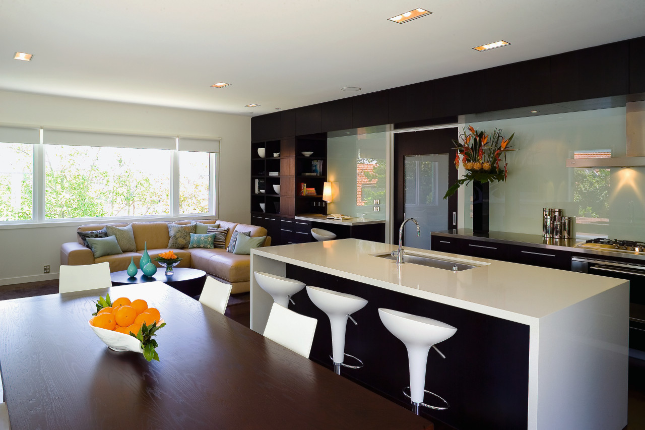 The dining table, family area and kitchen share countertop, interior design, kitchen, living room, real estate, room, gray, black