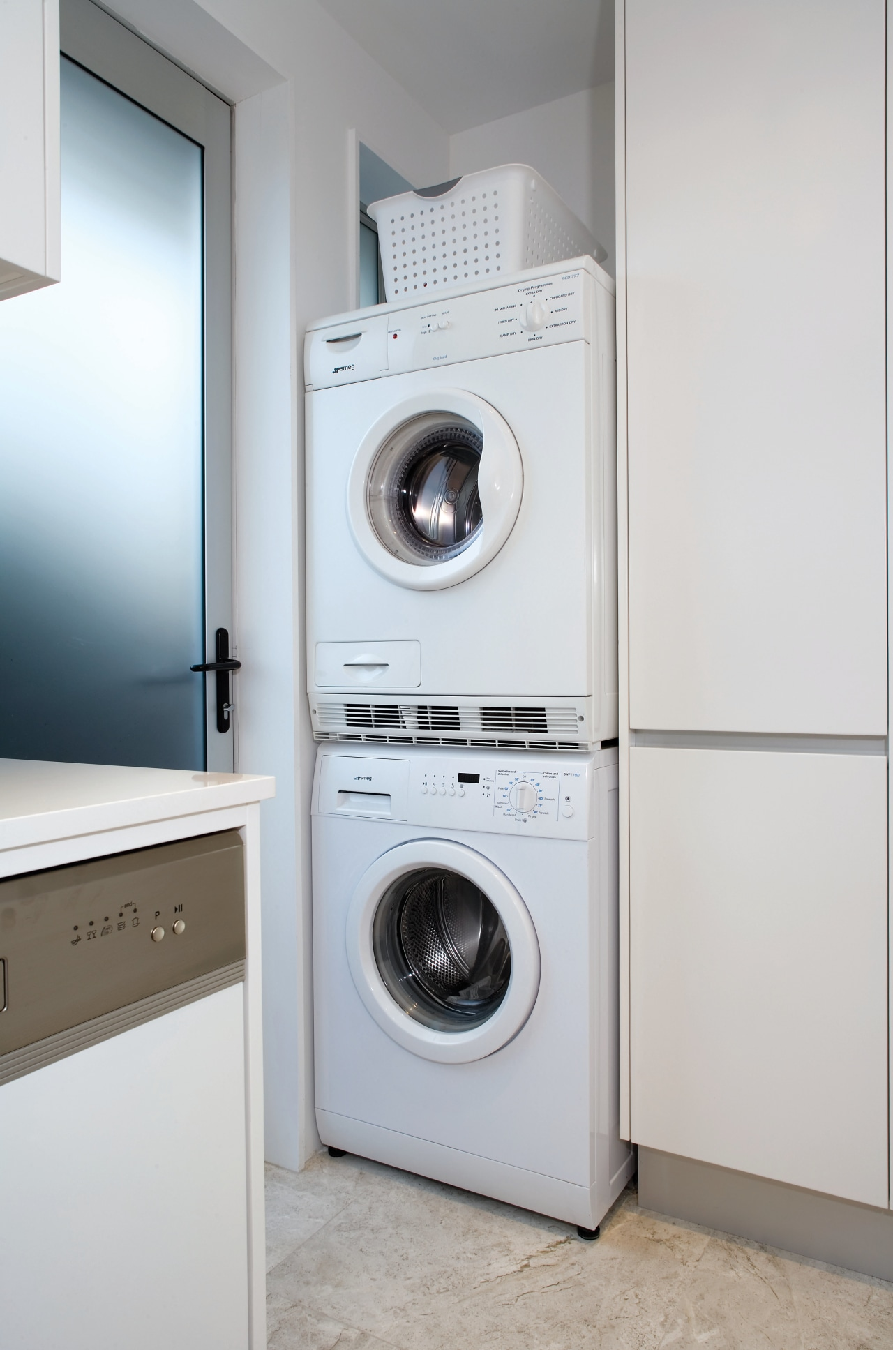 A view of the smeg washing machine and clothes dryer, home appliance, laundry, laundry room, major appliance, product, product design, room, washing machine, gray