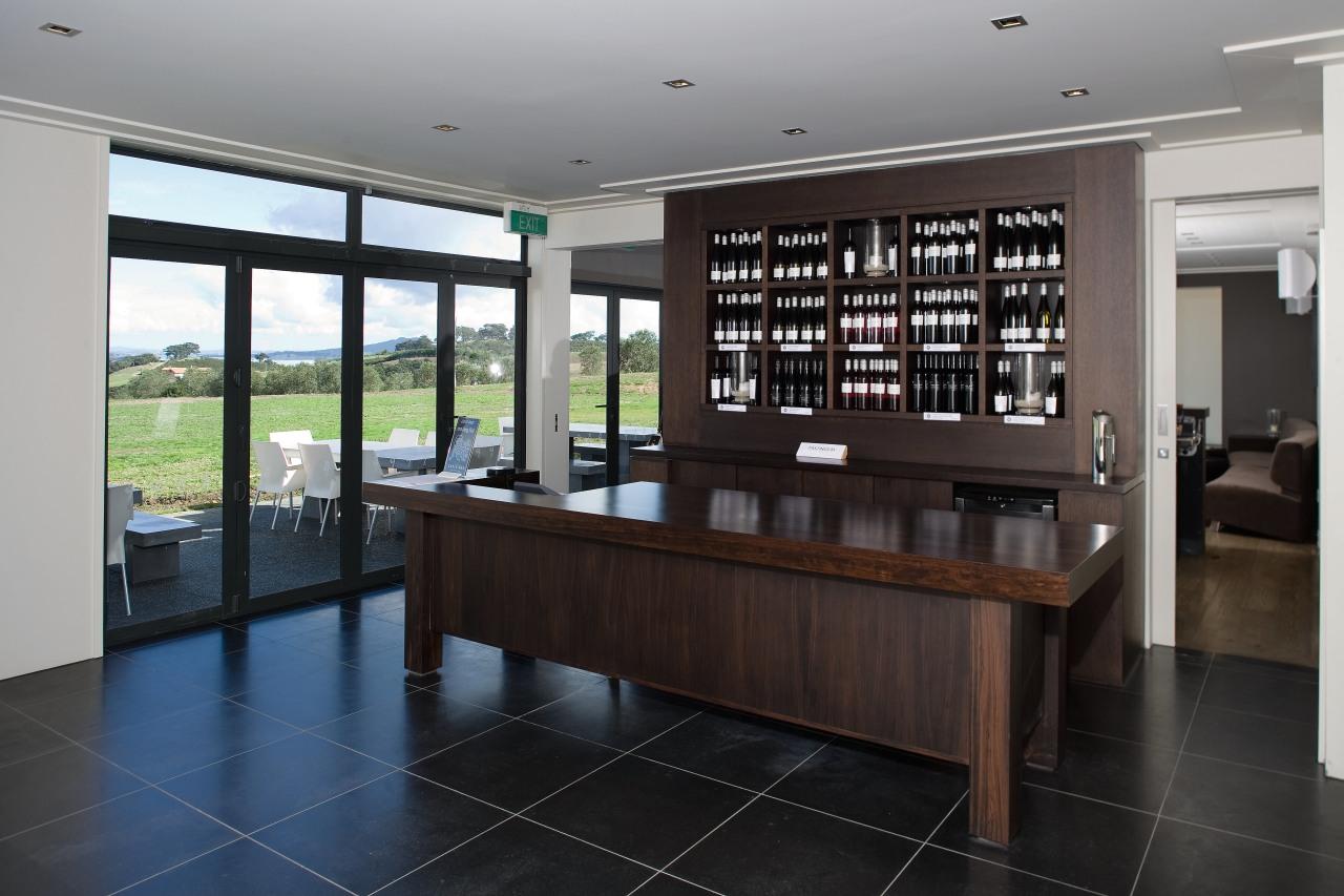 Arrangment of rooms is logica. The tasting room floor, flooring, furniture, interior design, real estate, table, black, gray