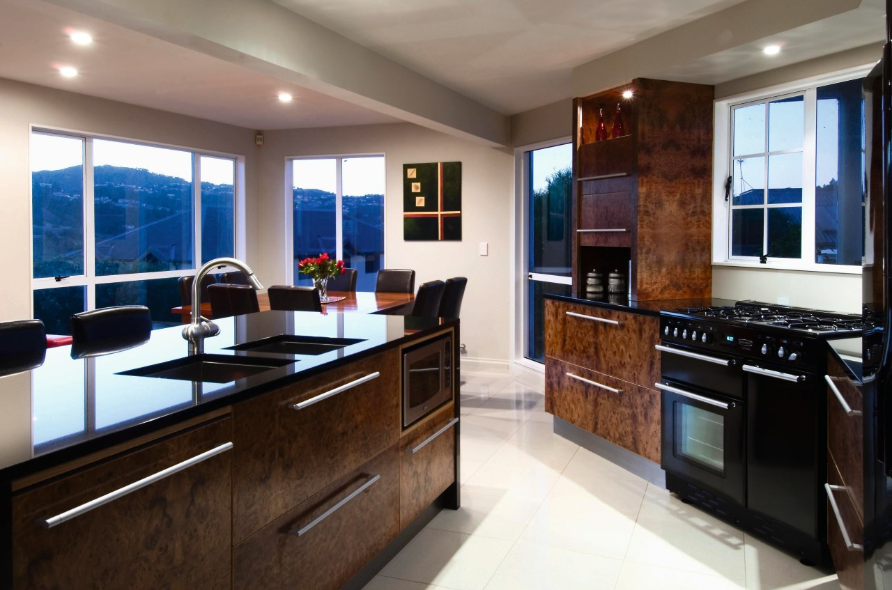 A view of this kitchen featuring blur elm cabinetry, countertop, cuisine classique, interior design, kitchen, real estate, room, brown, white