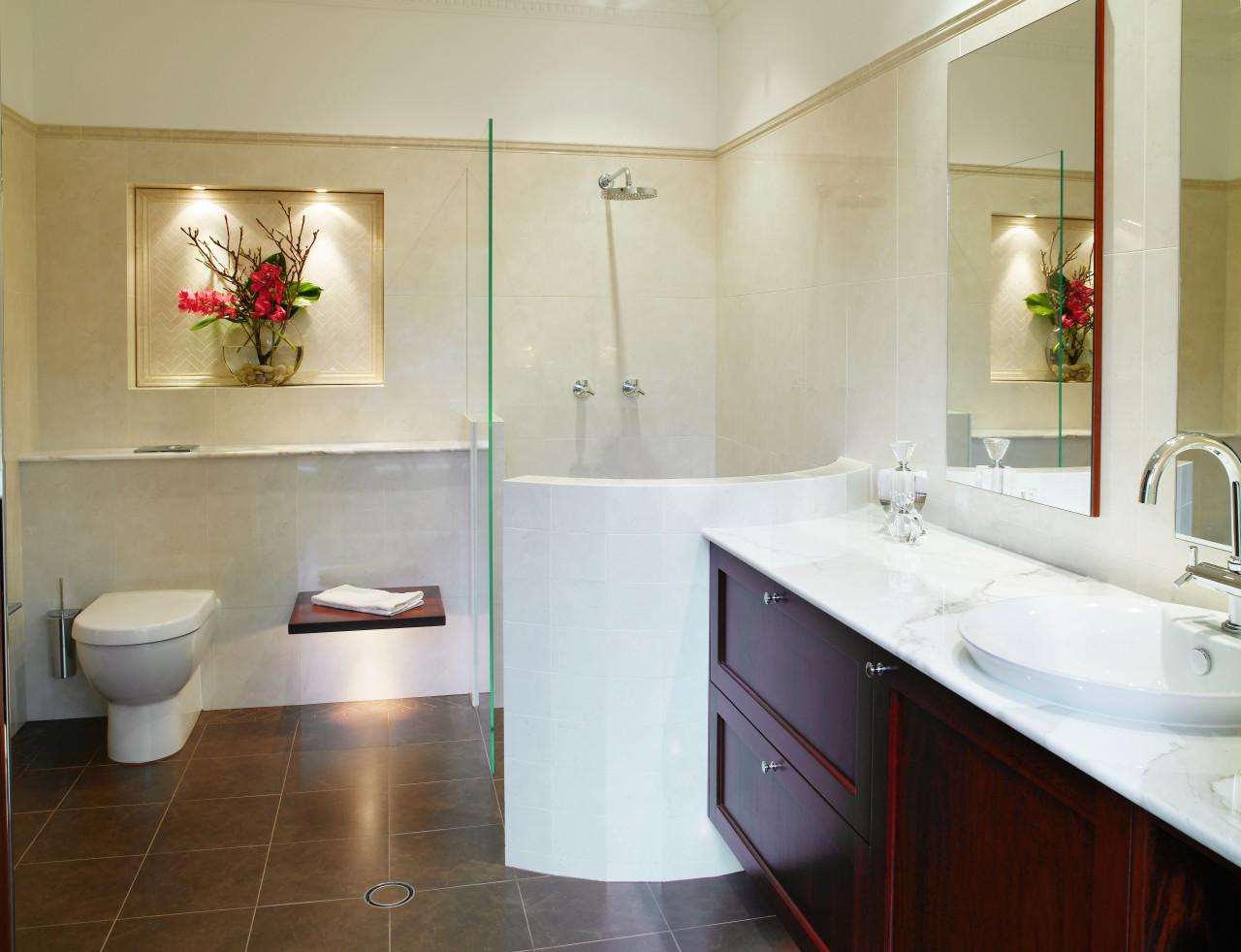 A view of the master ensuite, tiled floors bathroom, bathroom accessory, bathroom cabinet, floor, home, interior design, plumbing fixture, product design, real estate, room, sink, orange, gray