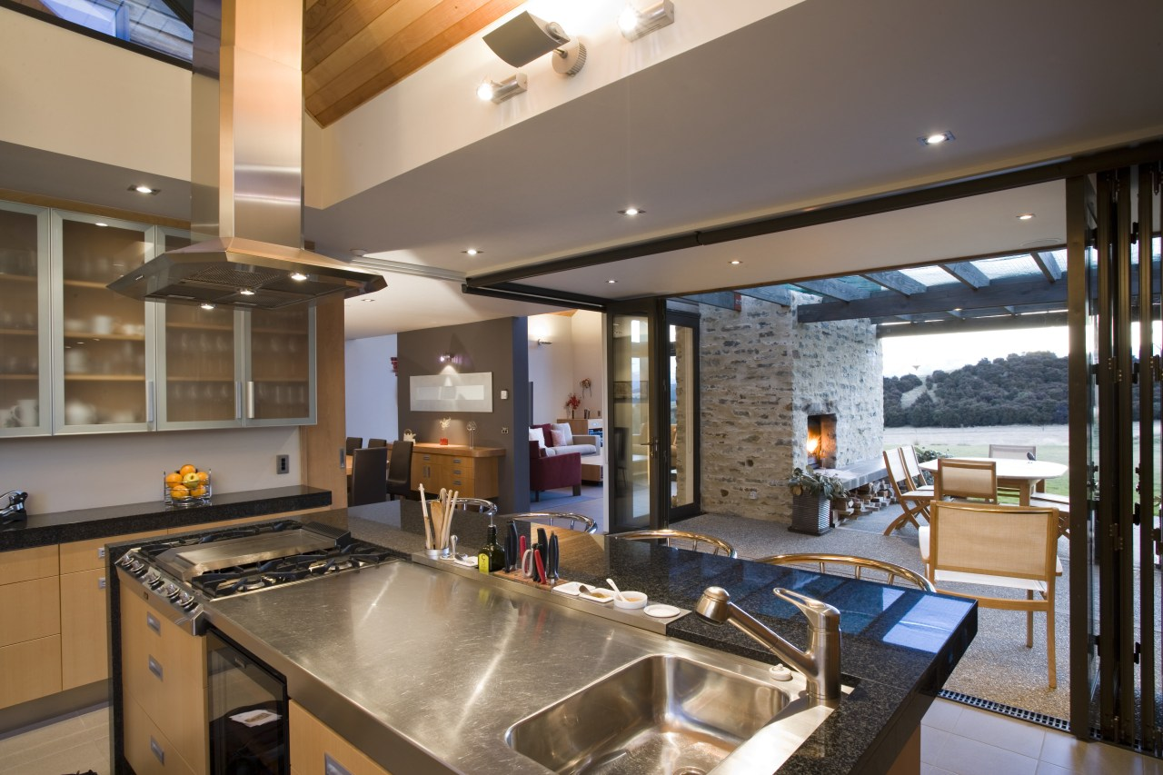 The formal living and dining areas can be countertop, interior design, kitchen, real estate, brown