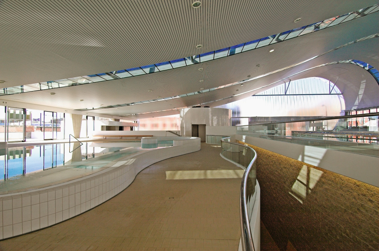 An interior view of the ian thorpe aquatic airport terminal, architecture, fixed link, infrastructure, leisure centre, metropolitan area, overpass, skyway, sport venue, structure, gray, brown
