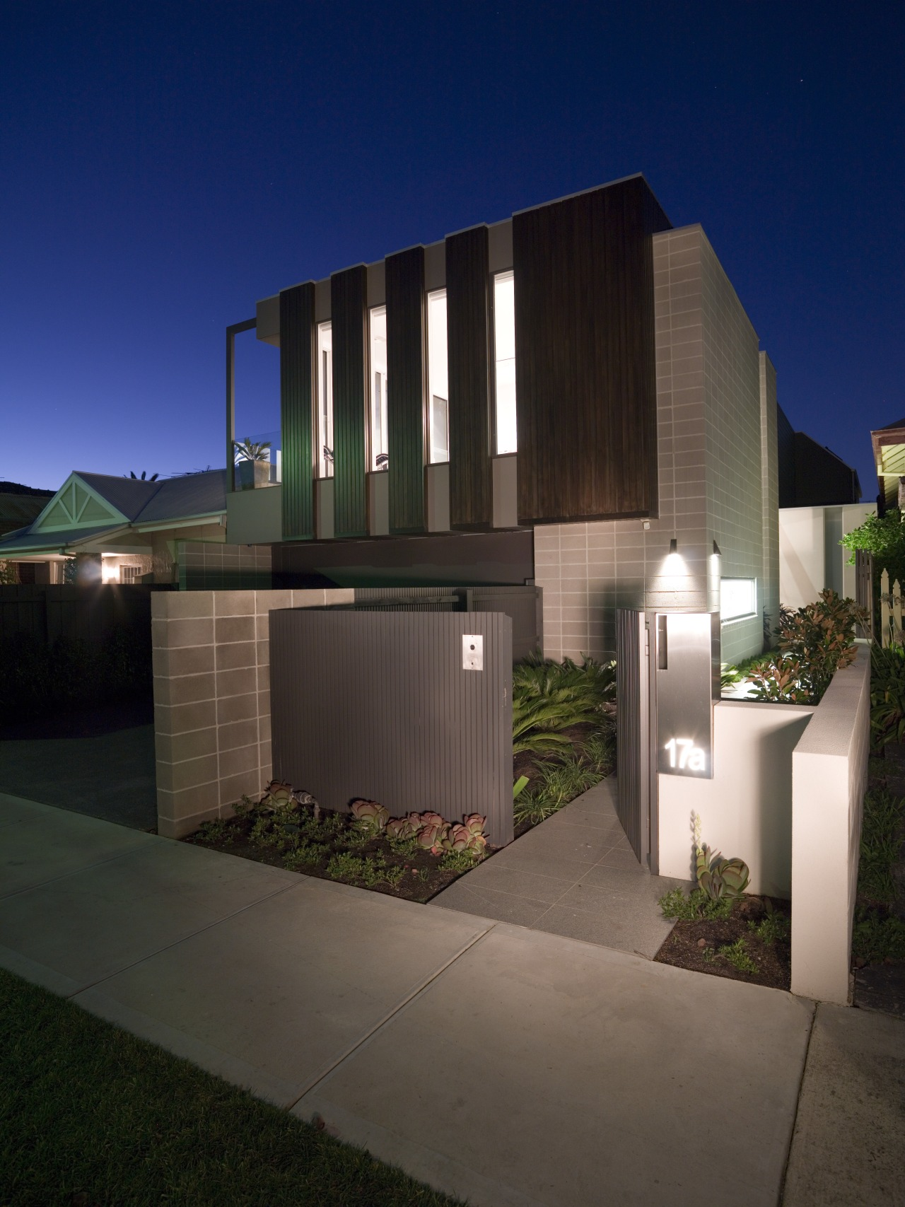 A cantilevered first storey adds a sculptural elemnt architecture, building, condominium, estate, facade, home, house, property, real estate, residential area, black, blue