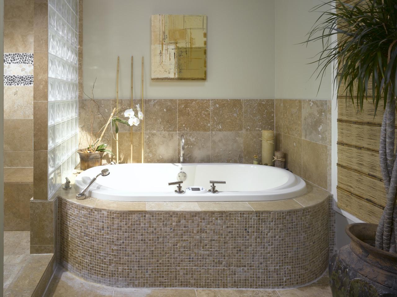 Small travertine tiles on the front of the bathroom, bathtub, floor, flooring, interior design, plumbing fixture, room, tile, wall, brown, gray