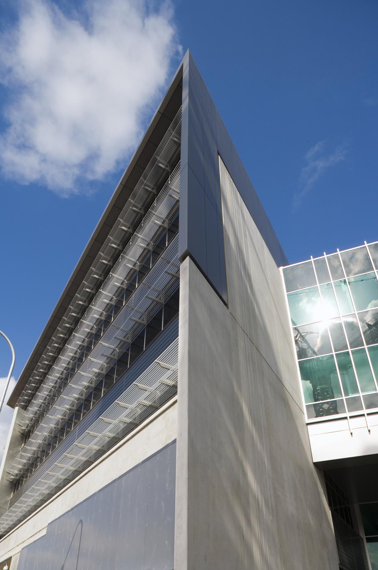 An exterior view of the greensquare building. DKL architecture, building, commercial building, condominium, corporate headquarters, daylighting, daytime, facade, headquarters, landmark, metropolis, metropolitan area, sky, skyscraper, gray, blue