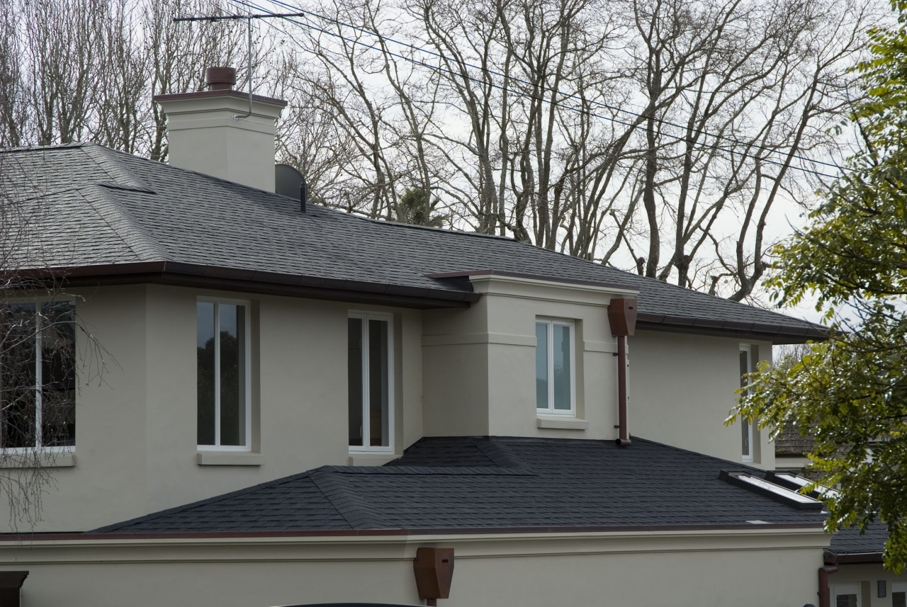 The Antique Black shingles on this house are building, daylighting, facade, home, house, outdoor structure, property, real estate, residential area, roof, siding, window, gray, black