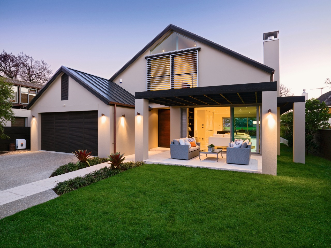 A view of a home custom built by backyard, cottage, elevation, estate, facade, home, house, property, real estate, residential area, roof, siding, villa, window, yard, green