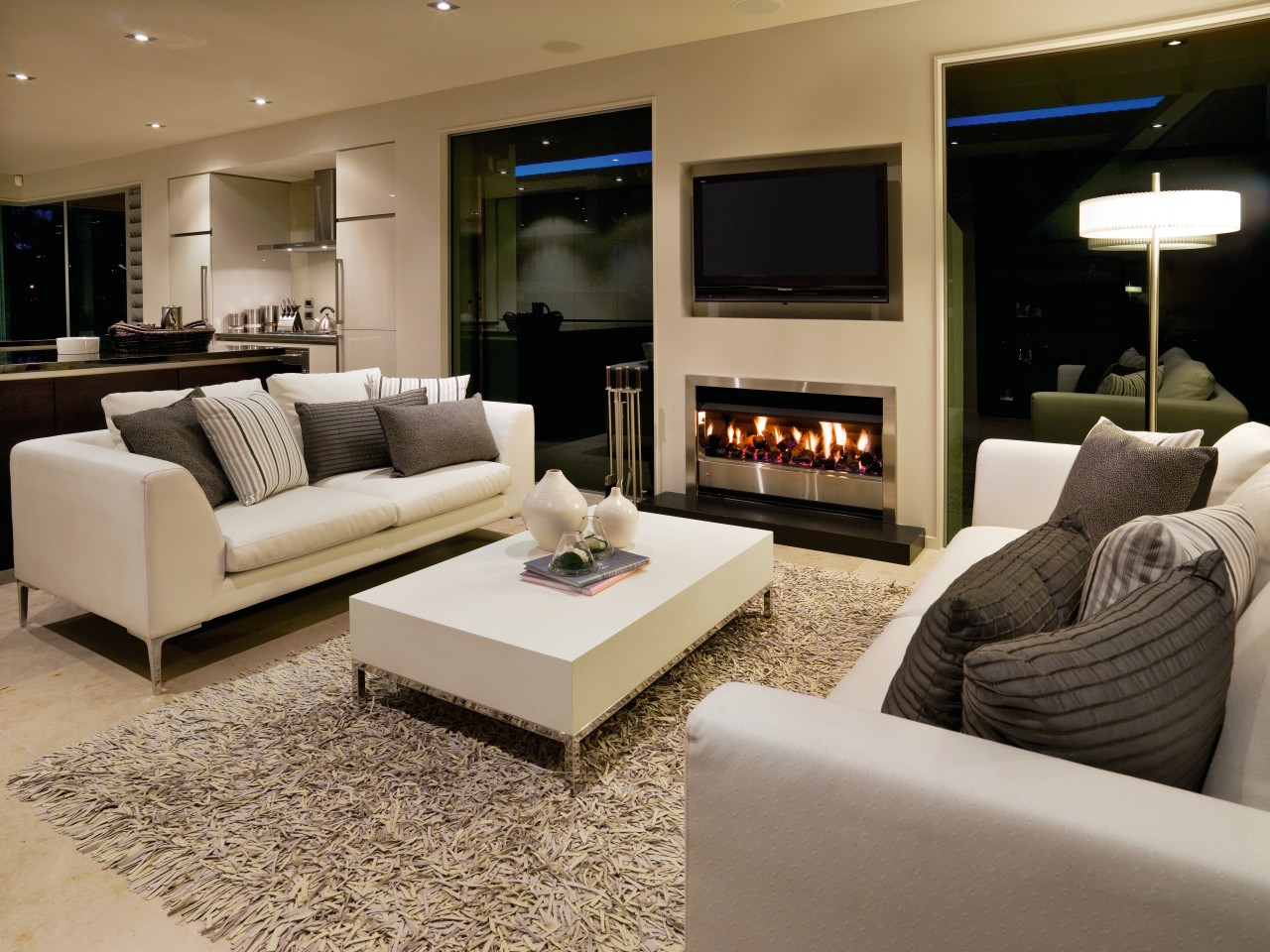A view of a home custom built by couch, floor, flooring, furniture, hearth, home, interior design, living room, room, brown, gray