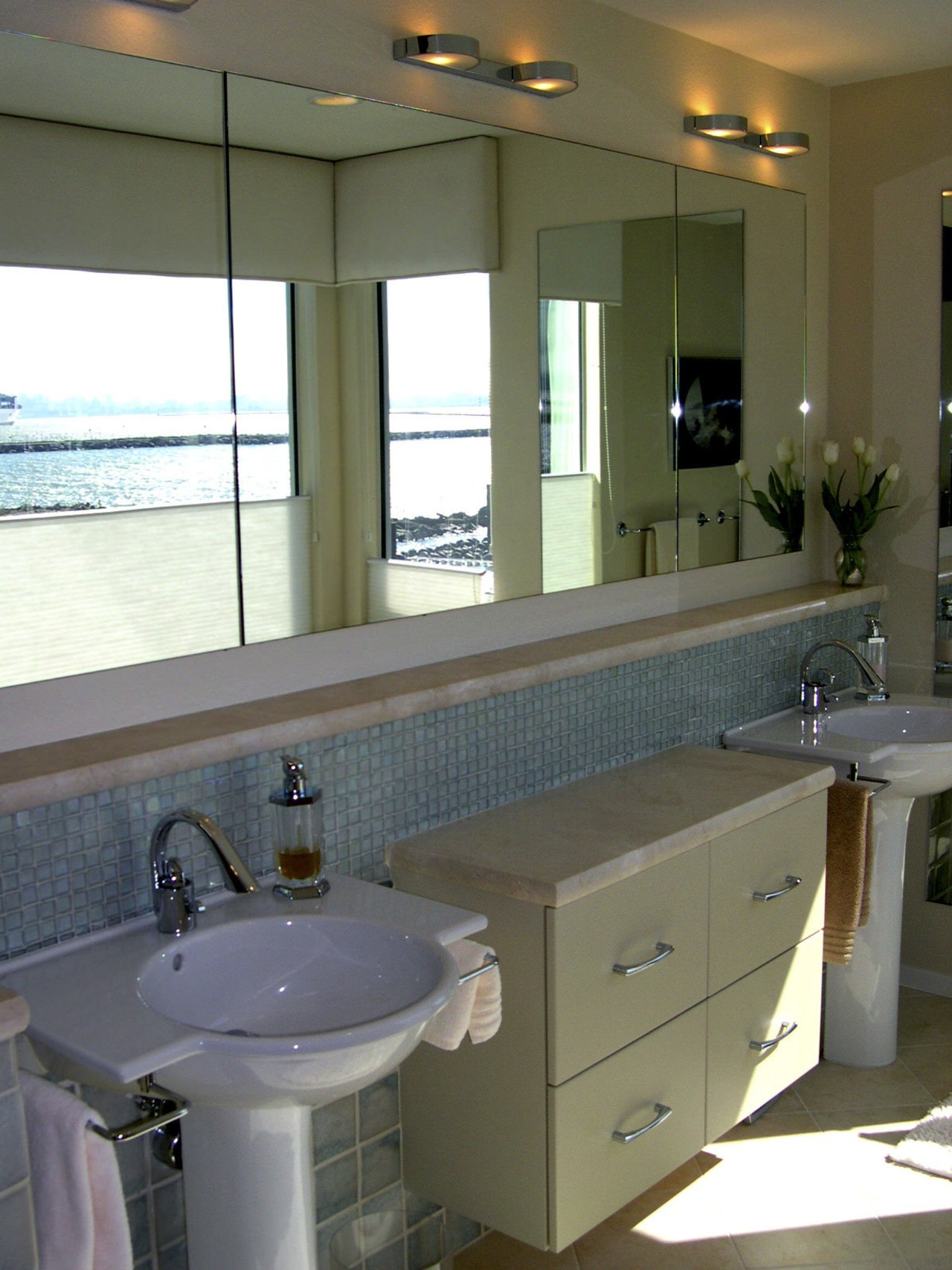 A view of some bathroomware from NKBA. bathroom, bathroom accessory, cabinetry, countertop, home, interior design, kitchen, room, sink, window, gray, brown