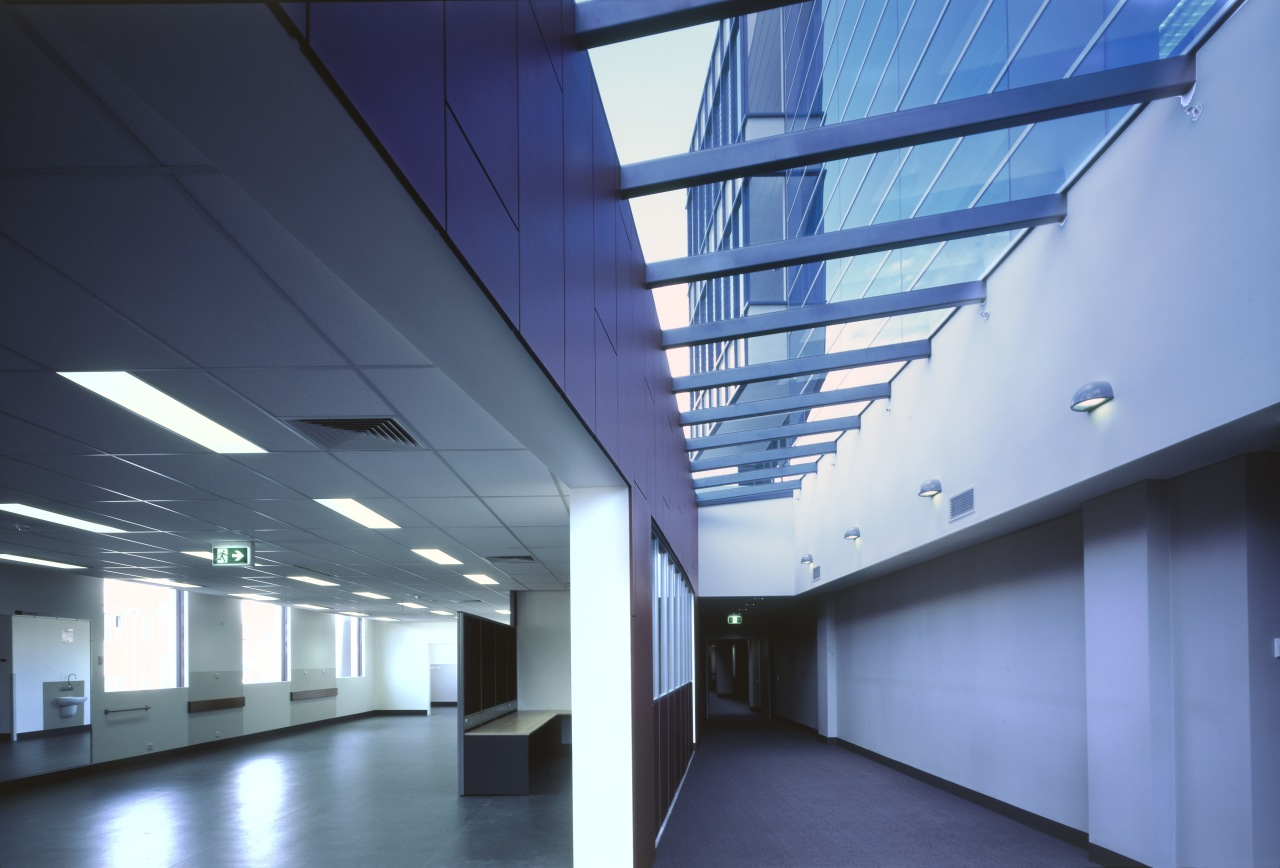 A skylight along the lenght of the building's architecture, ceiling, commercial building, corporate headquarters, daylighting, daytime, glass, headquarters, interior design, line, structure, teal, blue