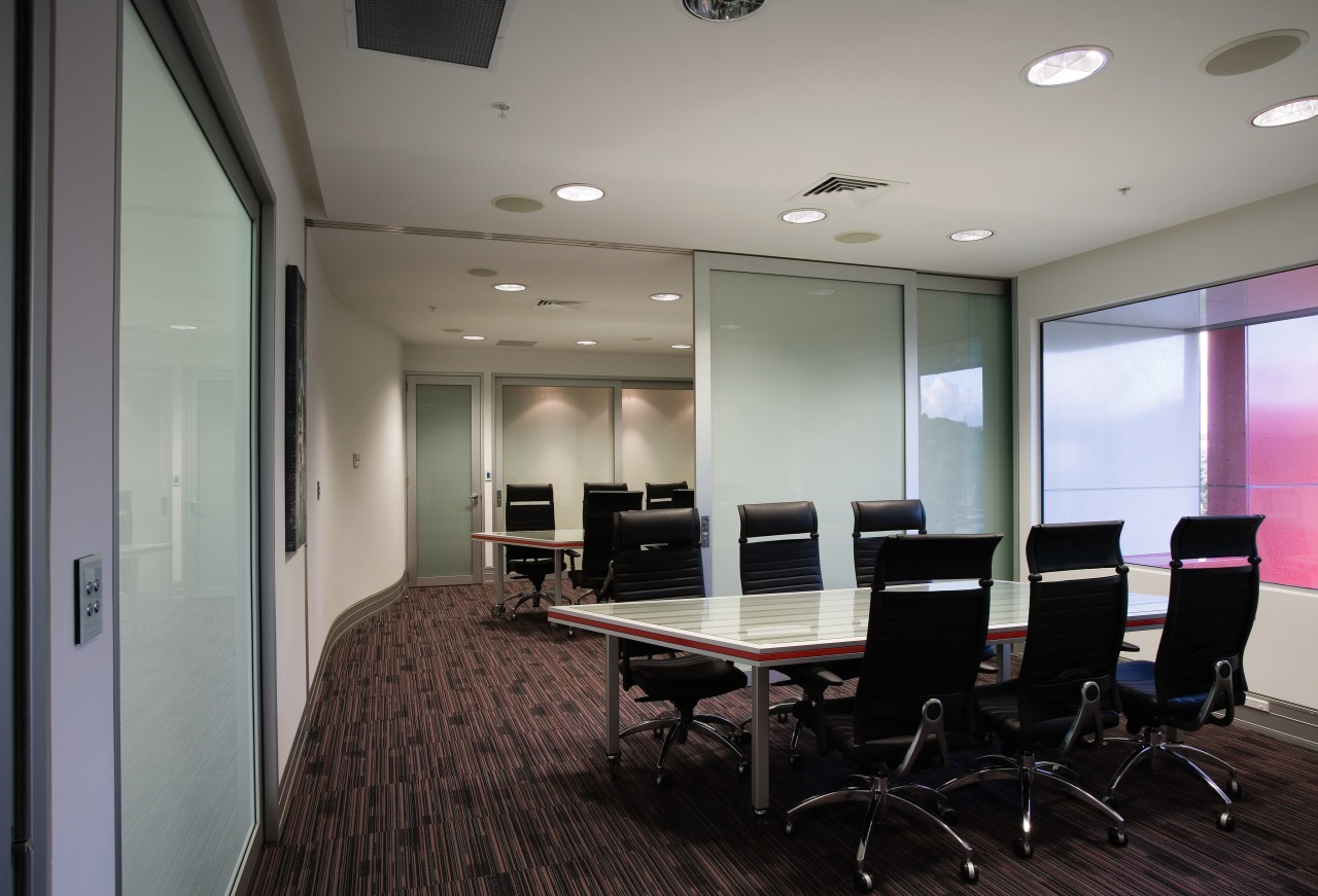Large sliding doors allow the boardroom to be ceiling, conference hall, floor, flooring, interior design, office, real estate, gray, black