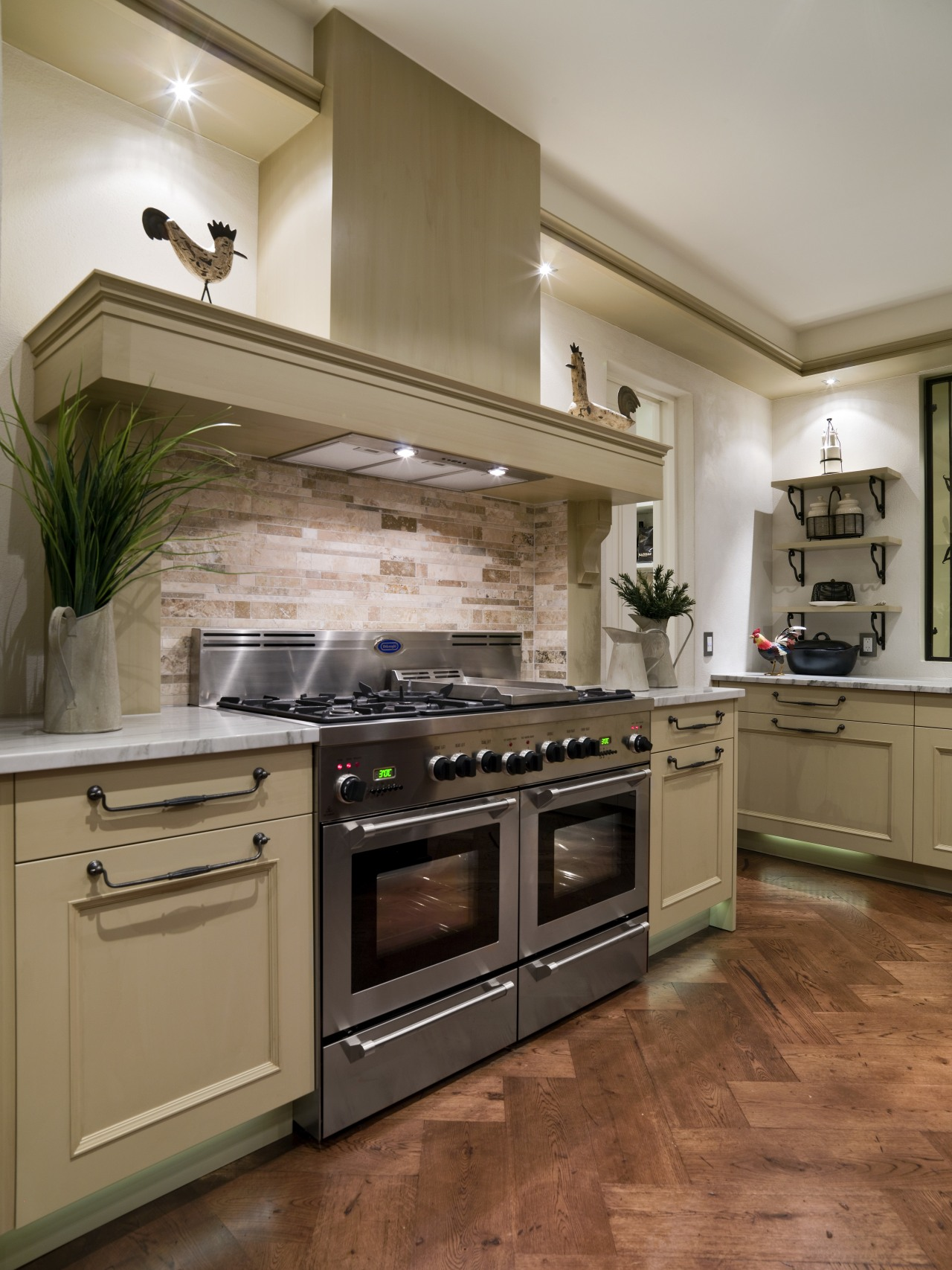 A view of some kitchen appliances from De'Longhi. cabinetry, countertop, cuisine classique, floor, flooring, hardwood, home appliance, interior design, kitchen, kitchen appliance, kitchen stove, major appliance, oven, room, wood flooring, brown, gray