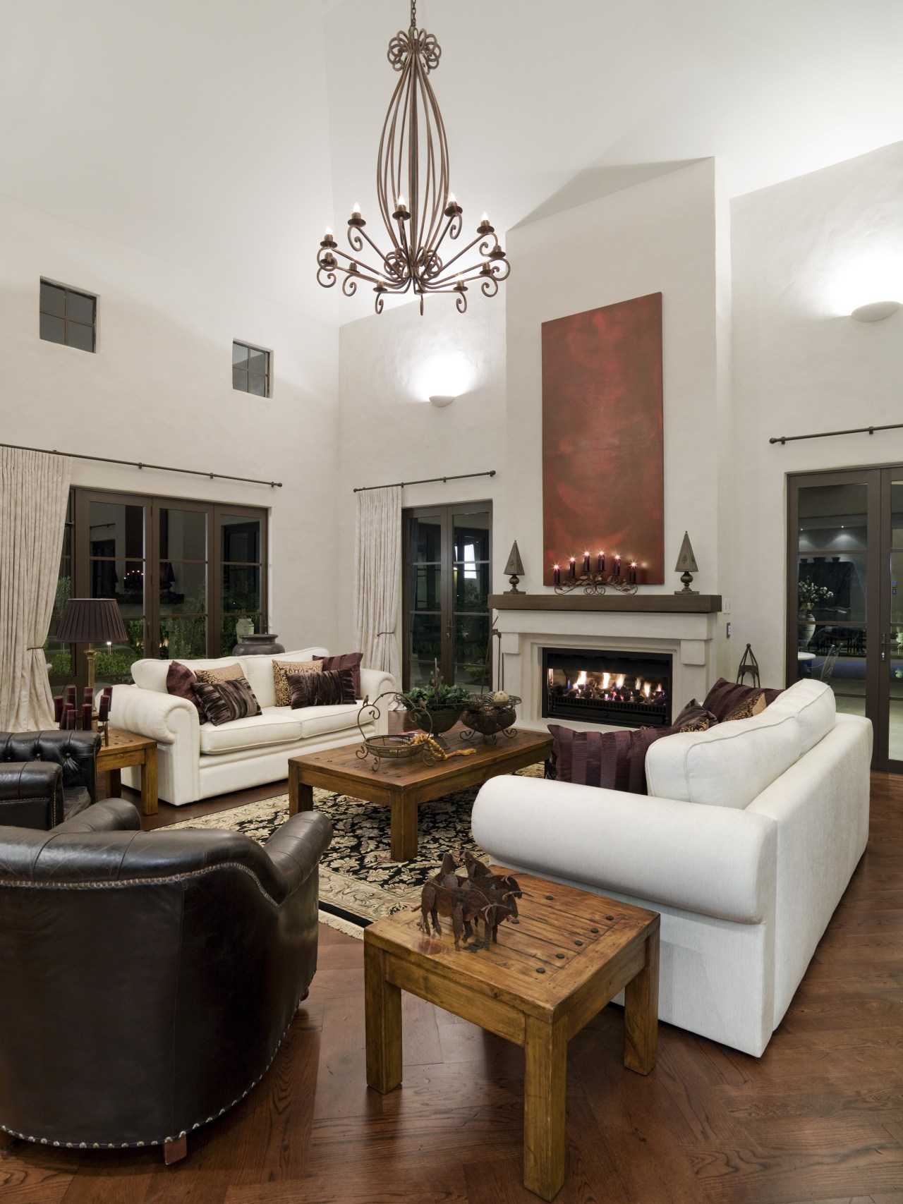 A view of a fireplace from Real Fires. ceiling, flooring, furniture, hardwood, home, interior design, living room, room, table, gray, brown