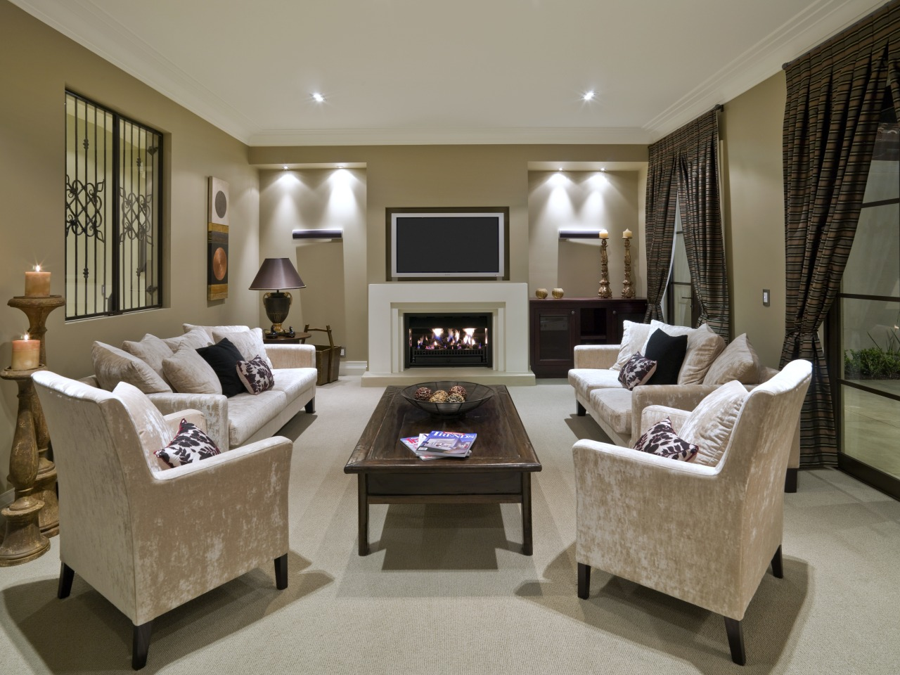 A view of a fireplace from Real Fires. floor, flooring, furniture, home, interior design, living room, real estate, room, window, brown, gray