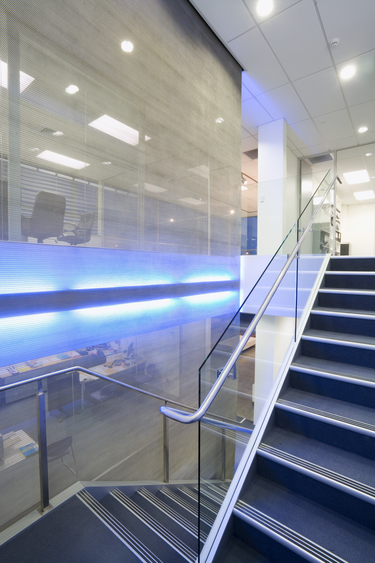 Stainless steel mesh is lit by a fluoresent architecture, ceiling, daylighting, glass, handrail, interior design, leisure centre, line, stairs, structure, gray, blue