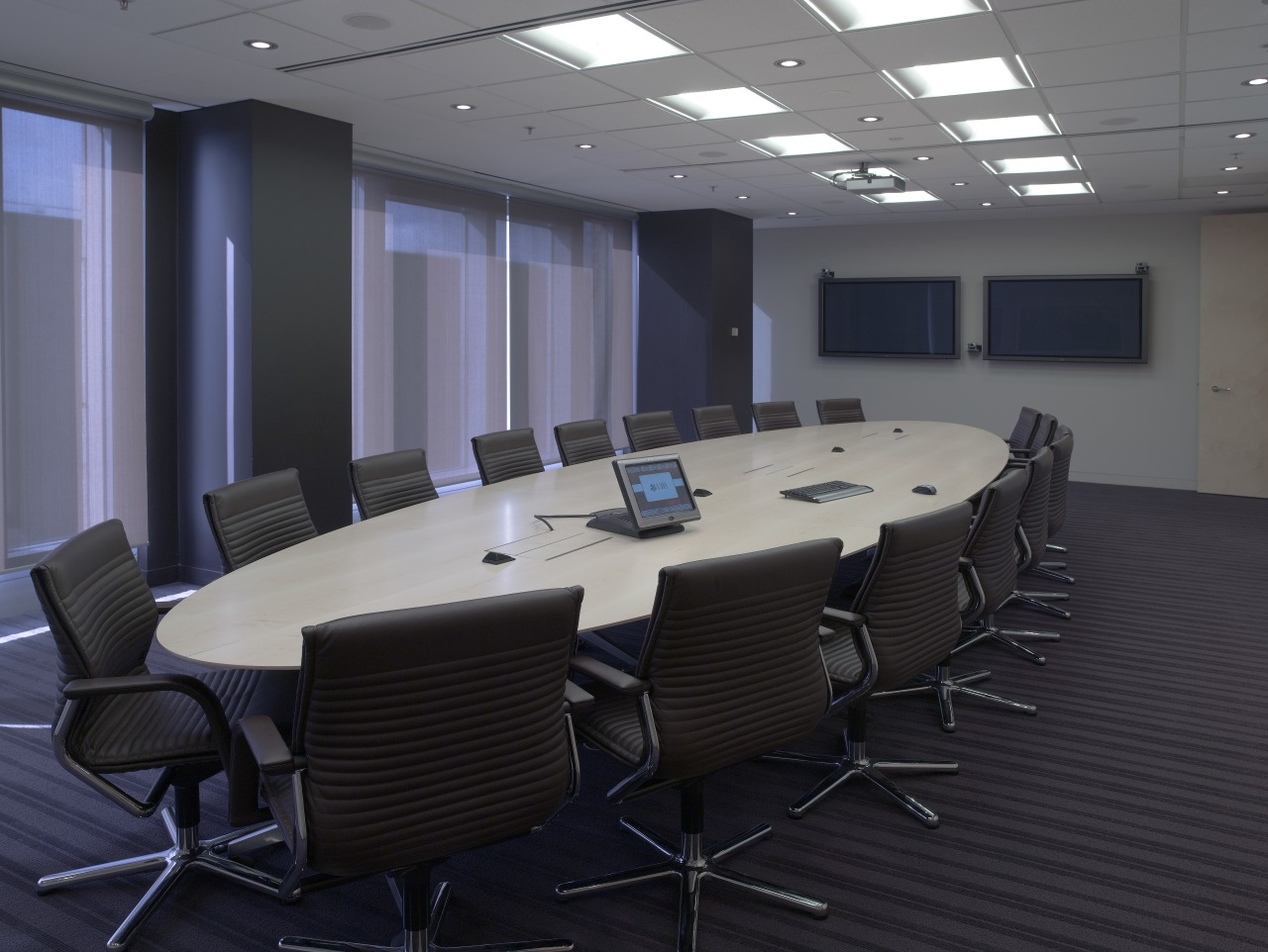 A view of the UBS offices, meetin rooms conference hall, furniture, interior design, office, table, black, gray