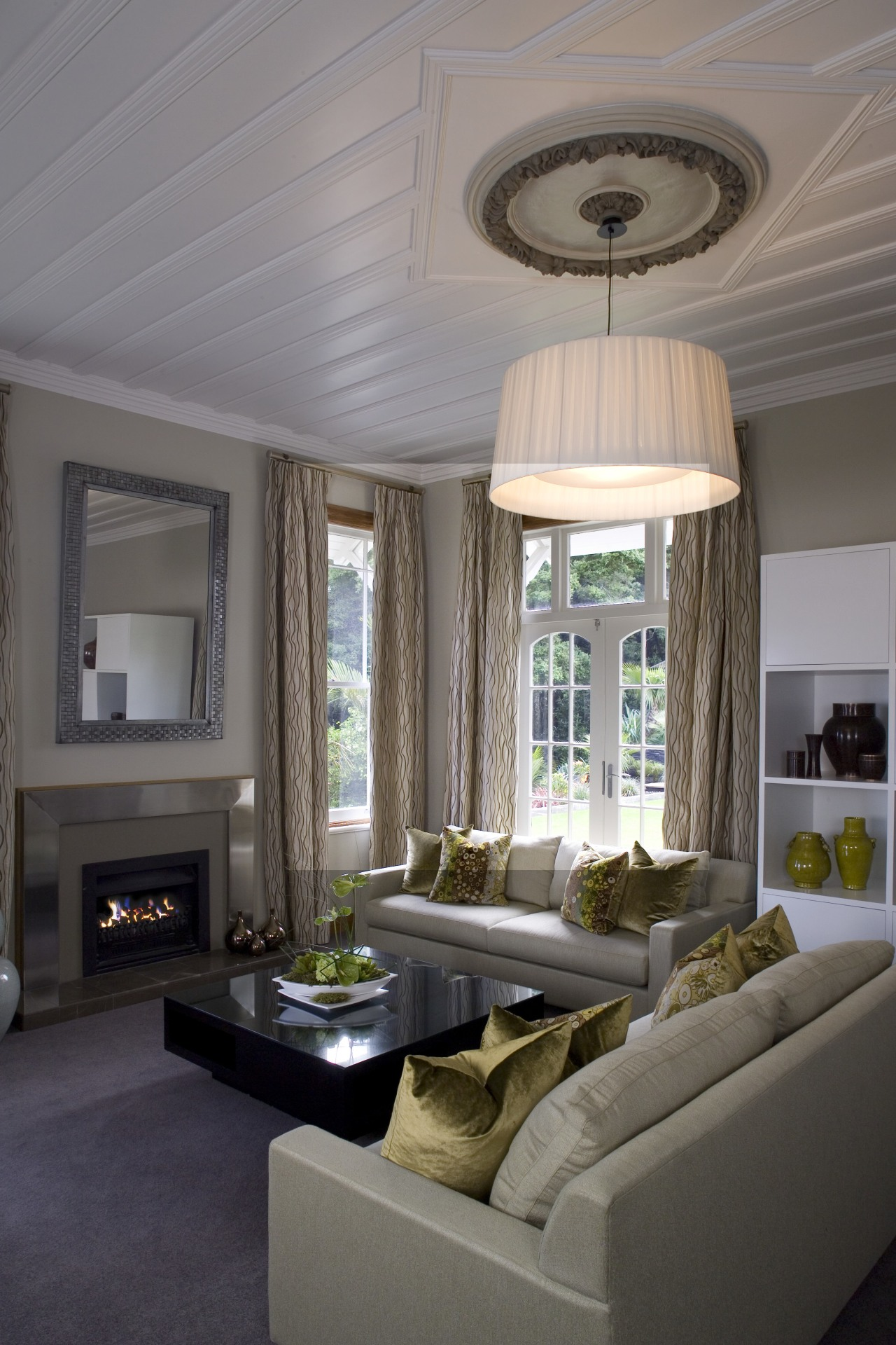 A view of the living area. ceiling, daylighting, home, interior design, living room, room, wall, window, window treatment, gray