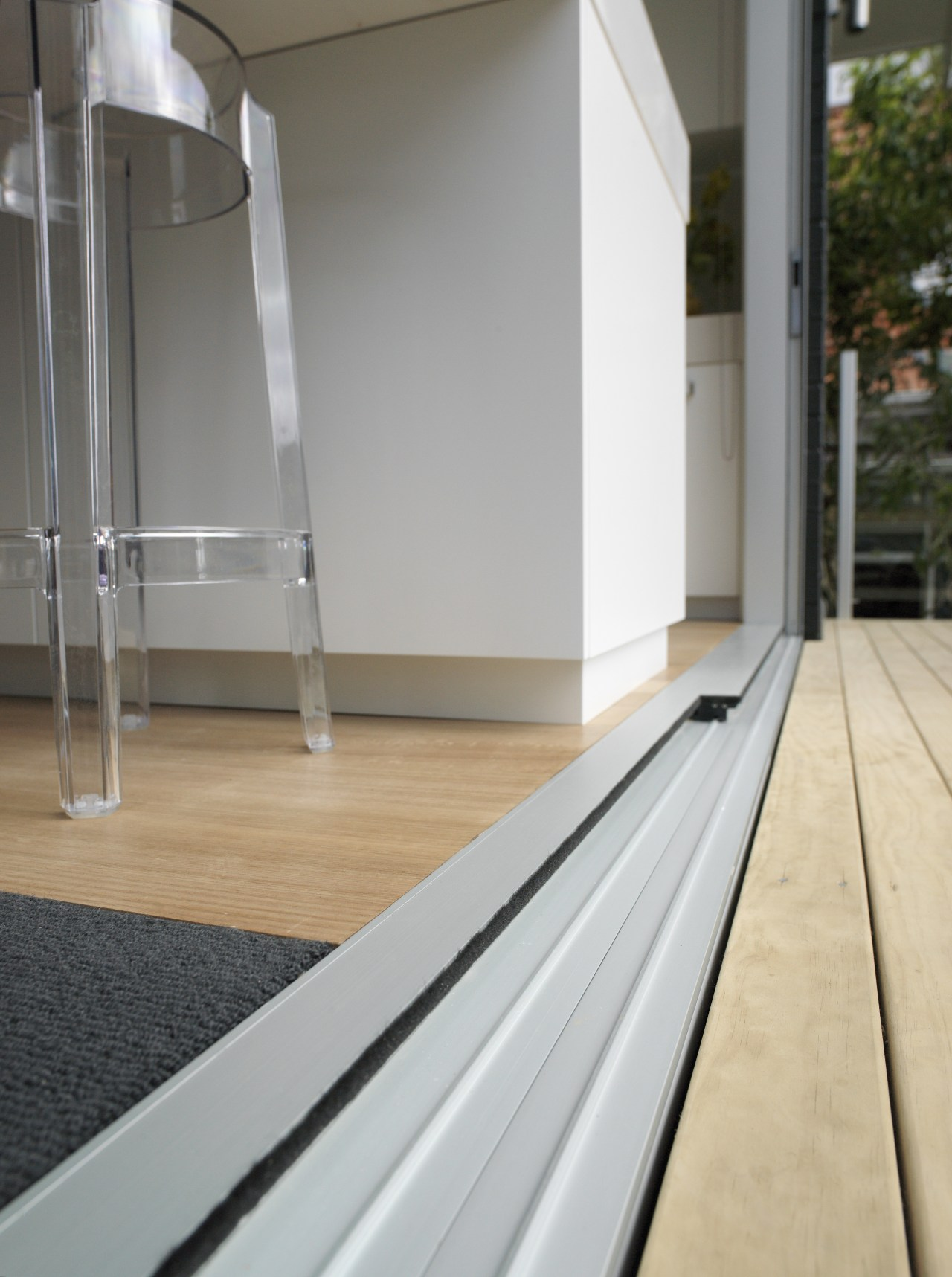 A view of some door and window joinery architecture, floor, flooring, glass, window, wood, gray