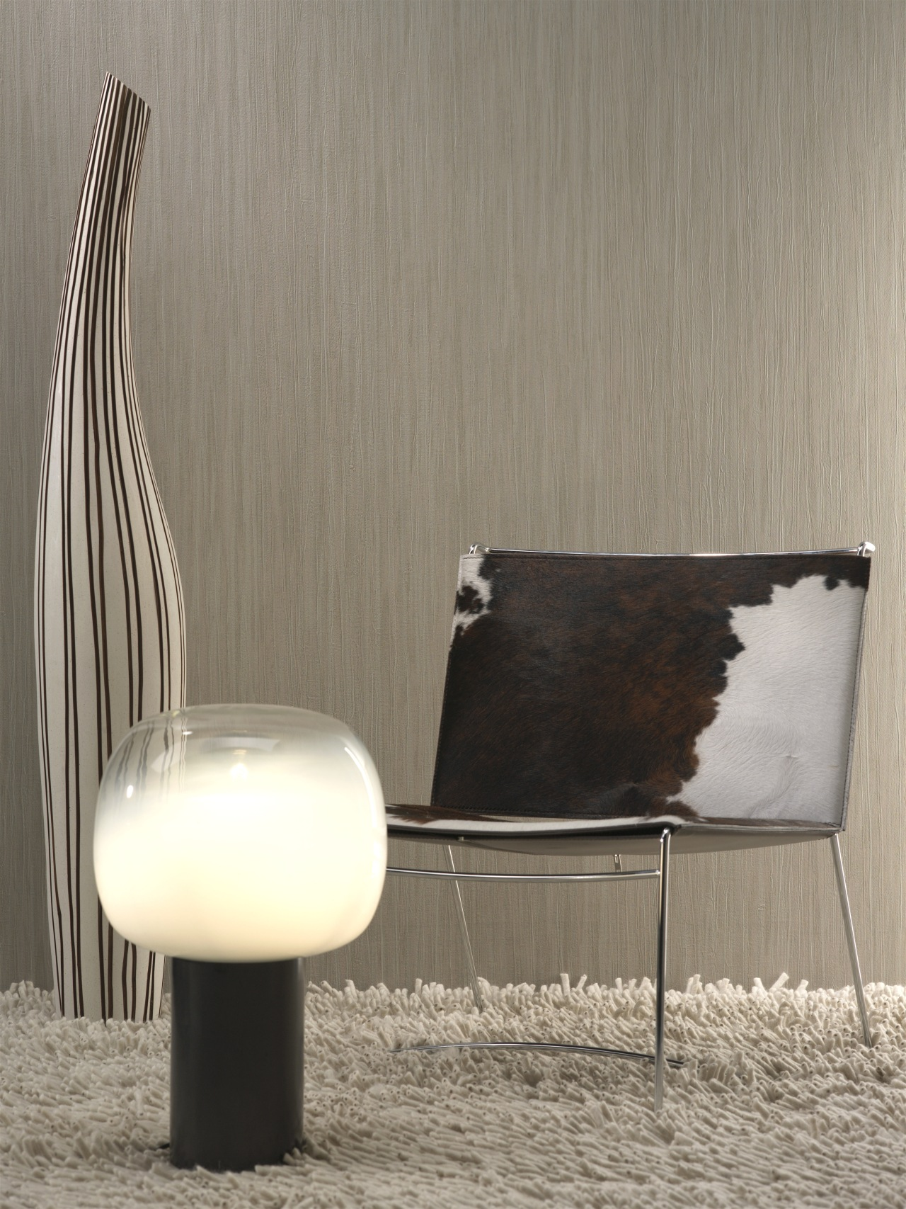 A view of some wallpaper from Vision Wallcoverings. chair, floor, furniture, interior design, lamp, light fixture, lighting, product design, table, gray
