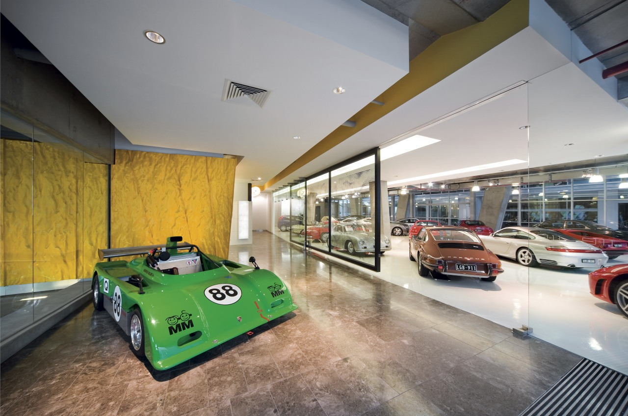Movement is suggested by the rippled yellow panels automotive design, car, car dealership, house, interior design, motor vehicle, property, gray